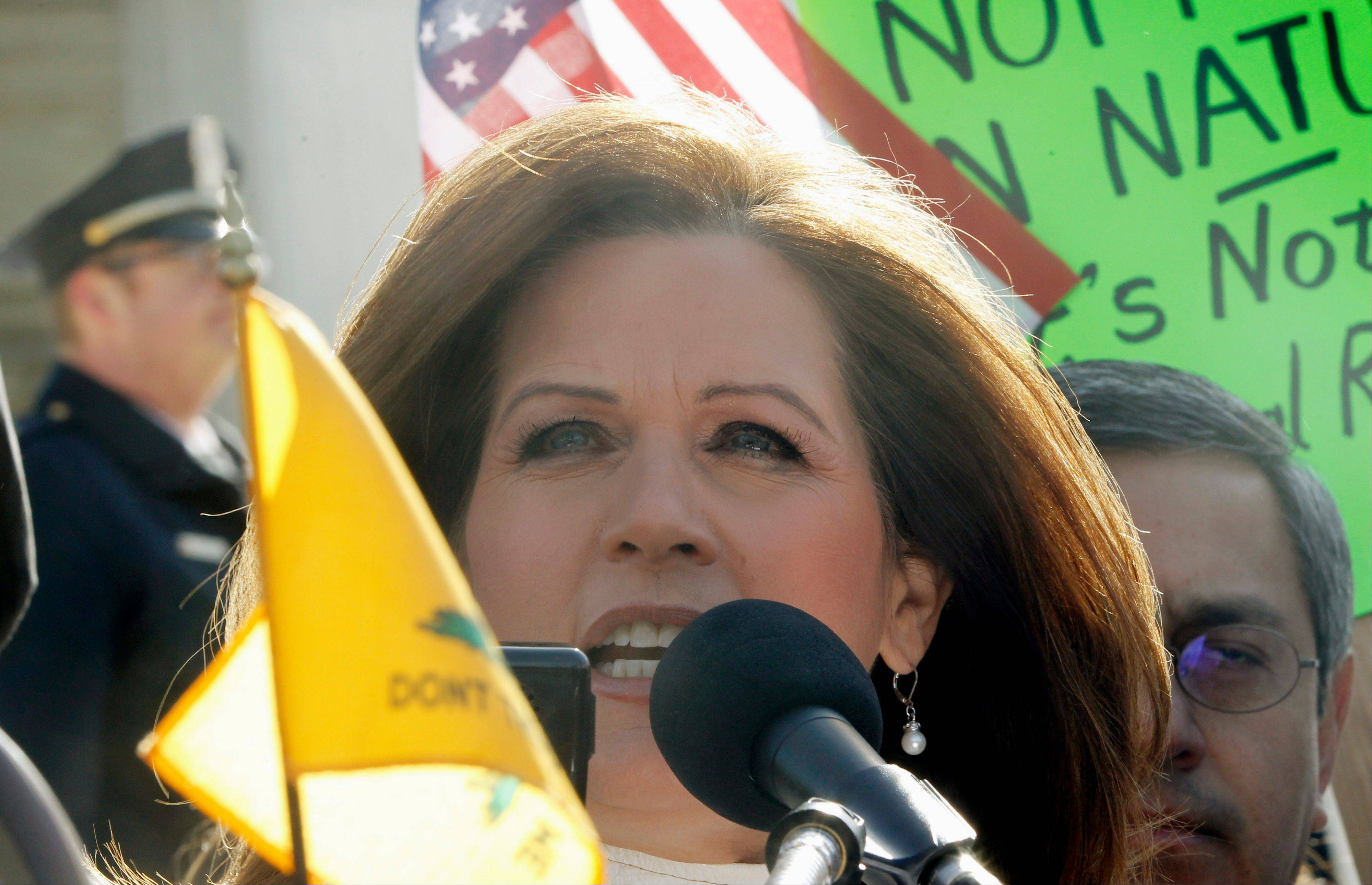 Associated Press Minnesota Republican Rep. Michele Bachmann addresses Tea Party supporters and opponents of health care reform Tuesday in front of the Supreme Court.
