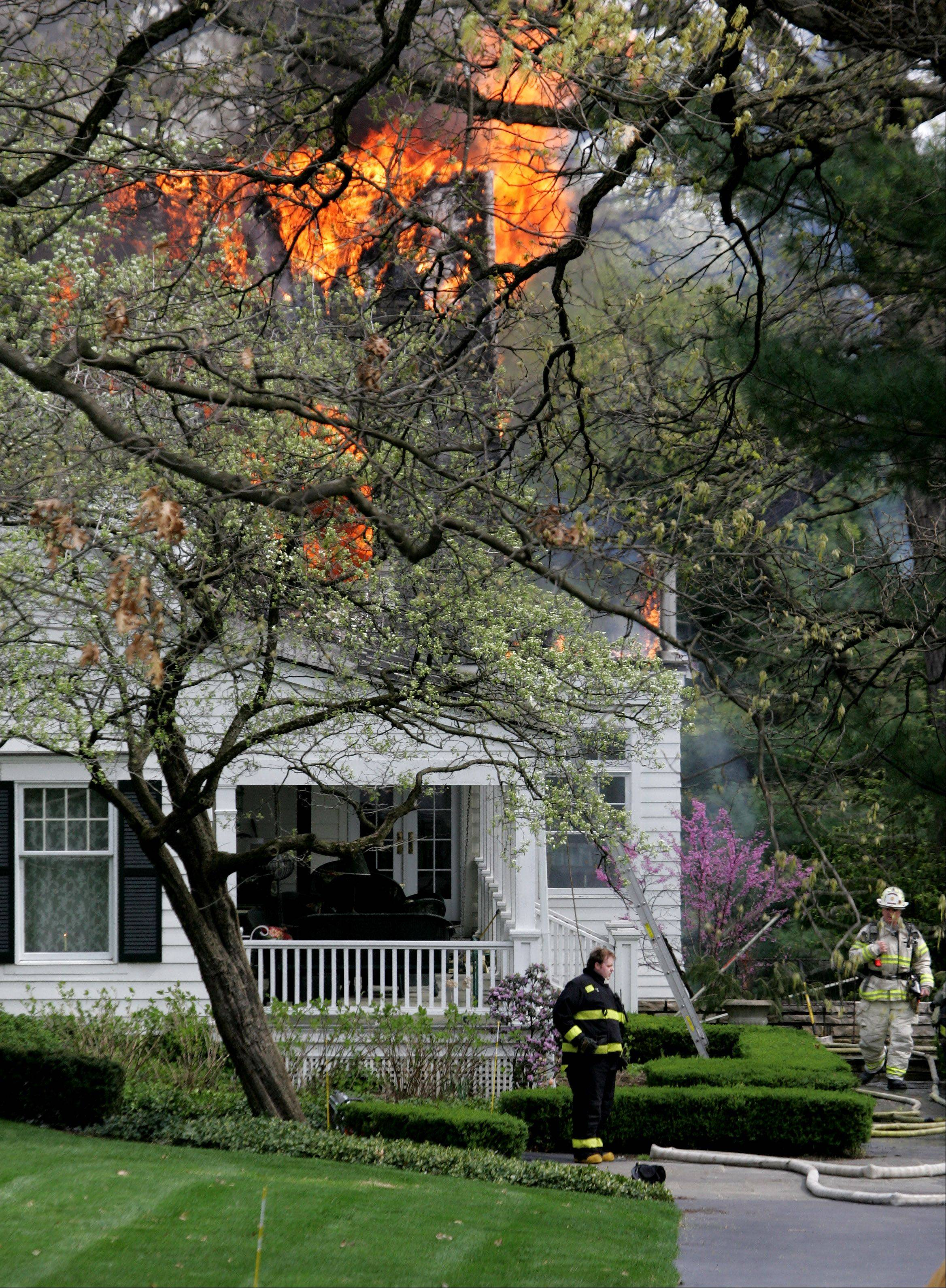 Firefighters from Glen Ellyn and neighboring departments battle a house fire Tuesday on the 1S400 block of Sunnybrook Lane.