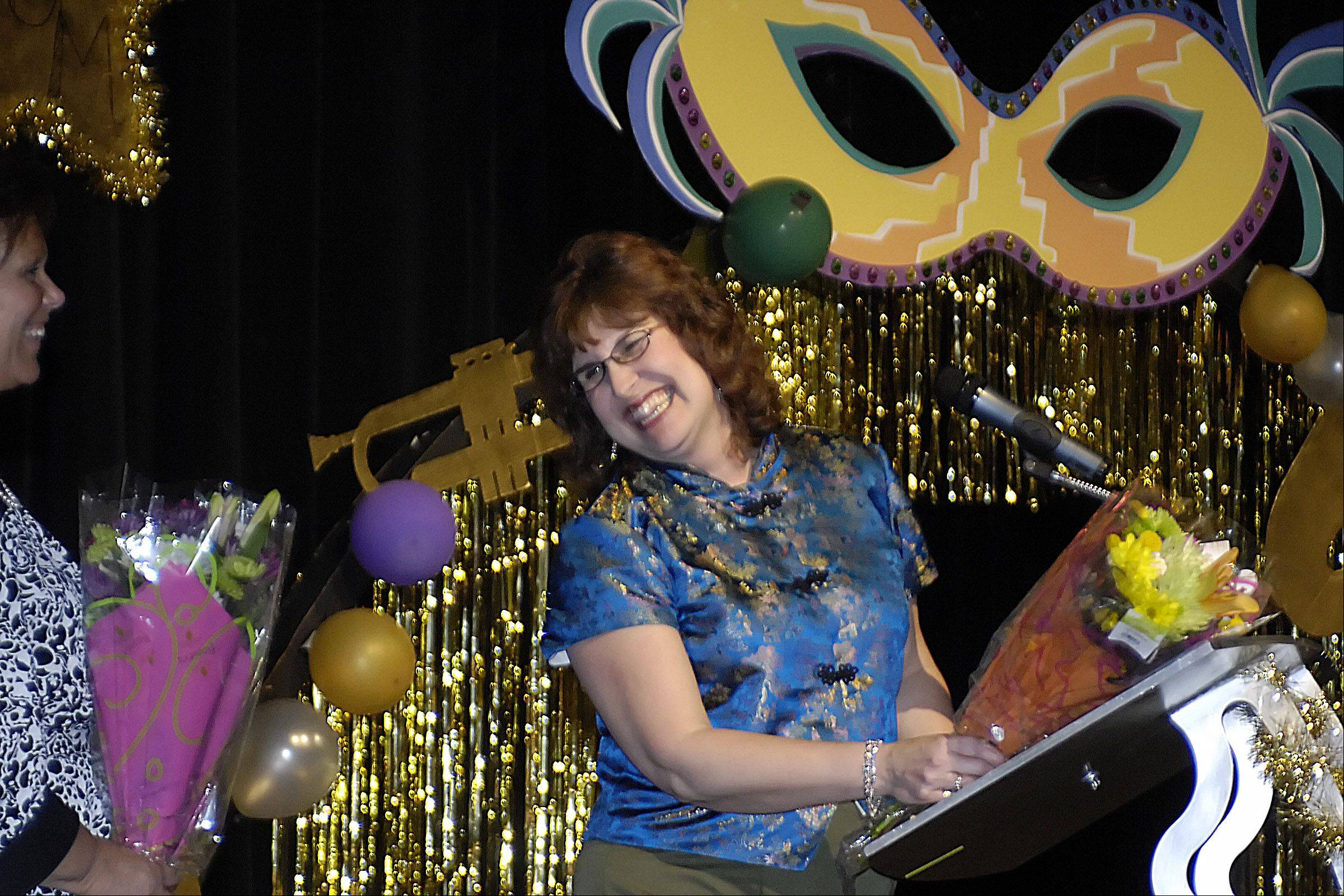 Carolyn Gilbert laughs onstage at a fashion show put on by Elgin High School students last month.