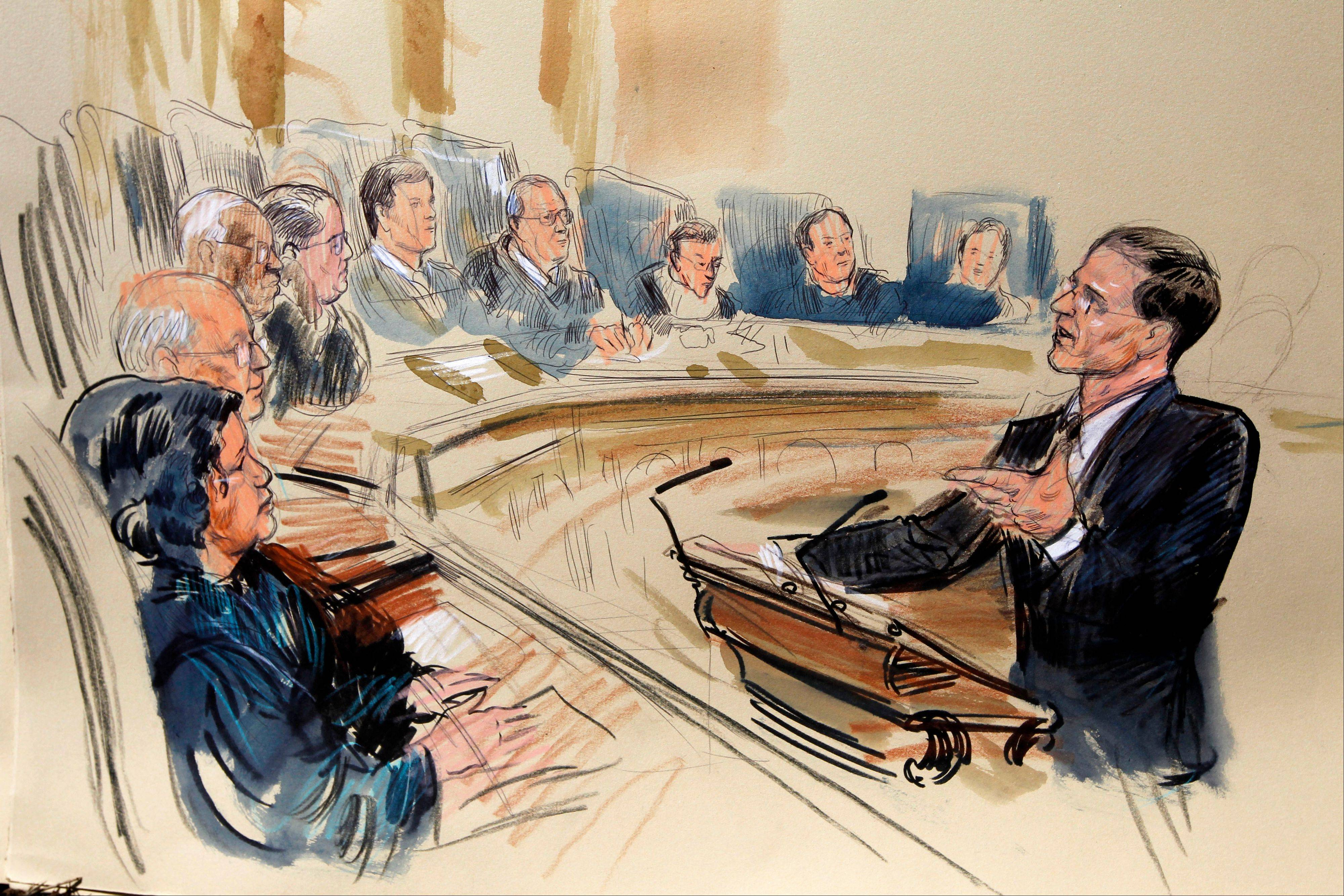 This artist rendering shows attorney Gregory G. Katsas speaking in front of the Supreme Court Justice in Washington on Monday as the court began three days of arguments on the health care law signed by President Barack Obama in Washington. Justices seated, from left are, Sonia Sotomayor, Stephen Breyer, Clarence Thomas, Antonin Scalia, Chief Justice John Roberts and Anthony Kennedy, Ruth Bader Ginsburg, Samuel Alito and Elena Kagan.