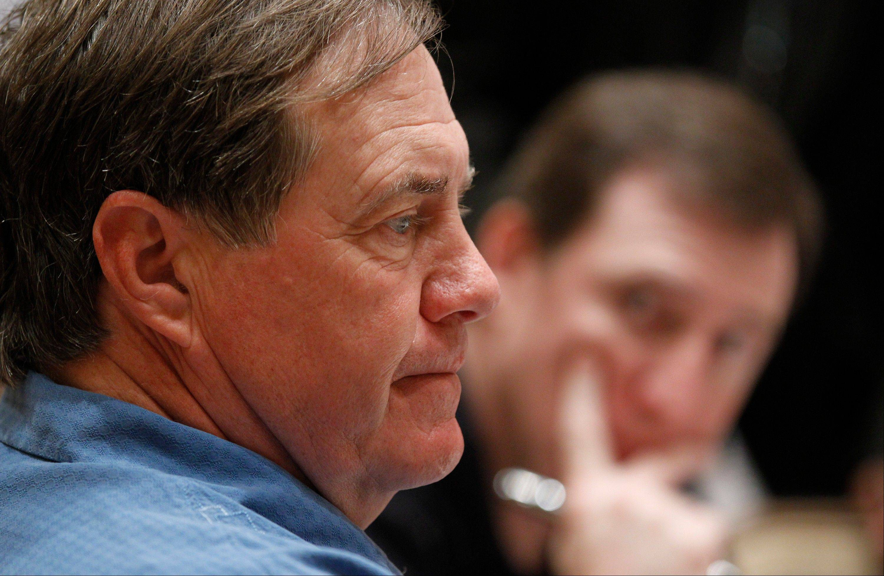 New England Patriots coach Bill Belichick listens to a question from a members of the media Tuesday during an interview at the NFL owners meeting in Palm Beach, Fla.