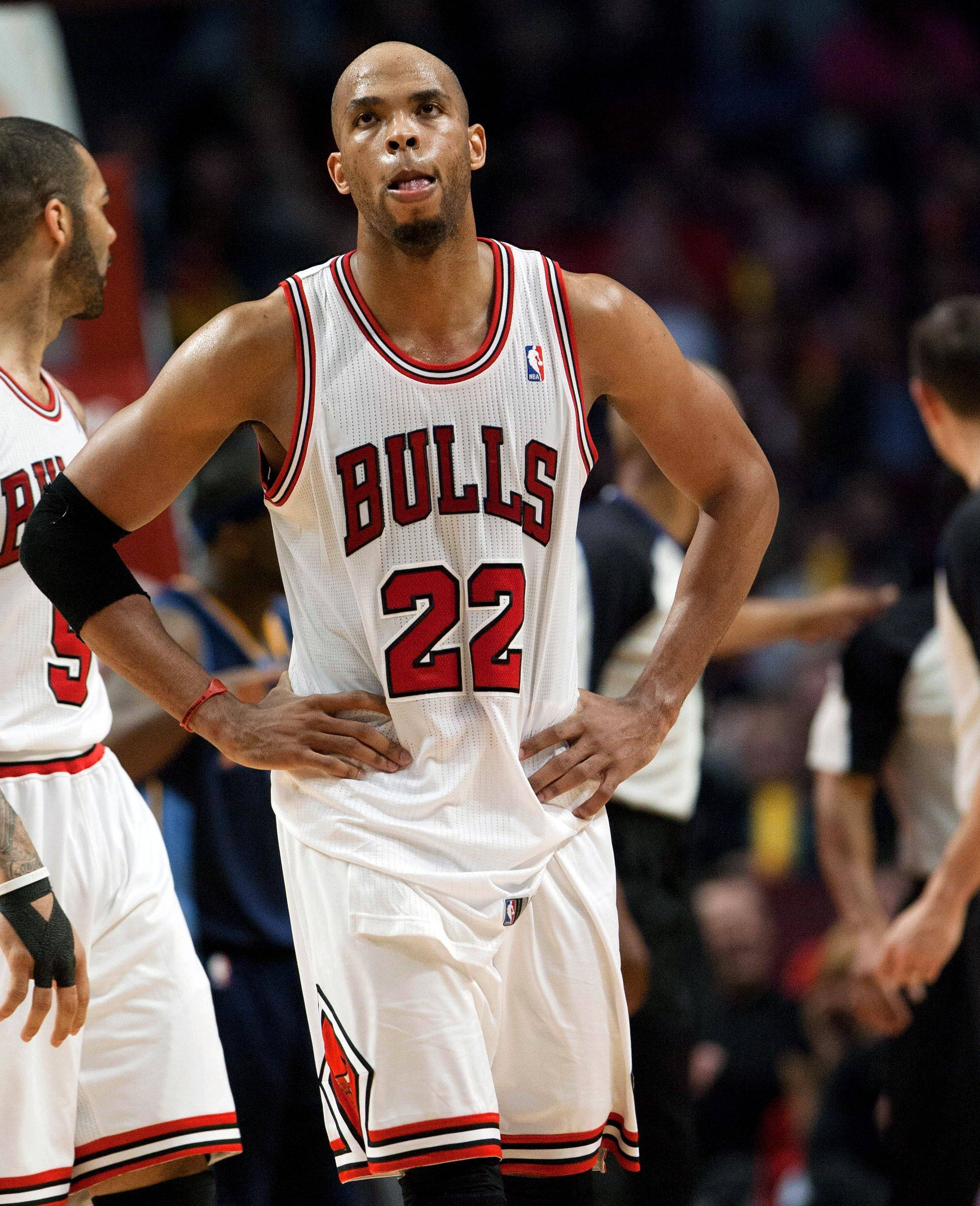 Taj Gibson doesn't like what he sees on the scoreboard as he looks up late in the game Monday night at the United Center.