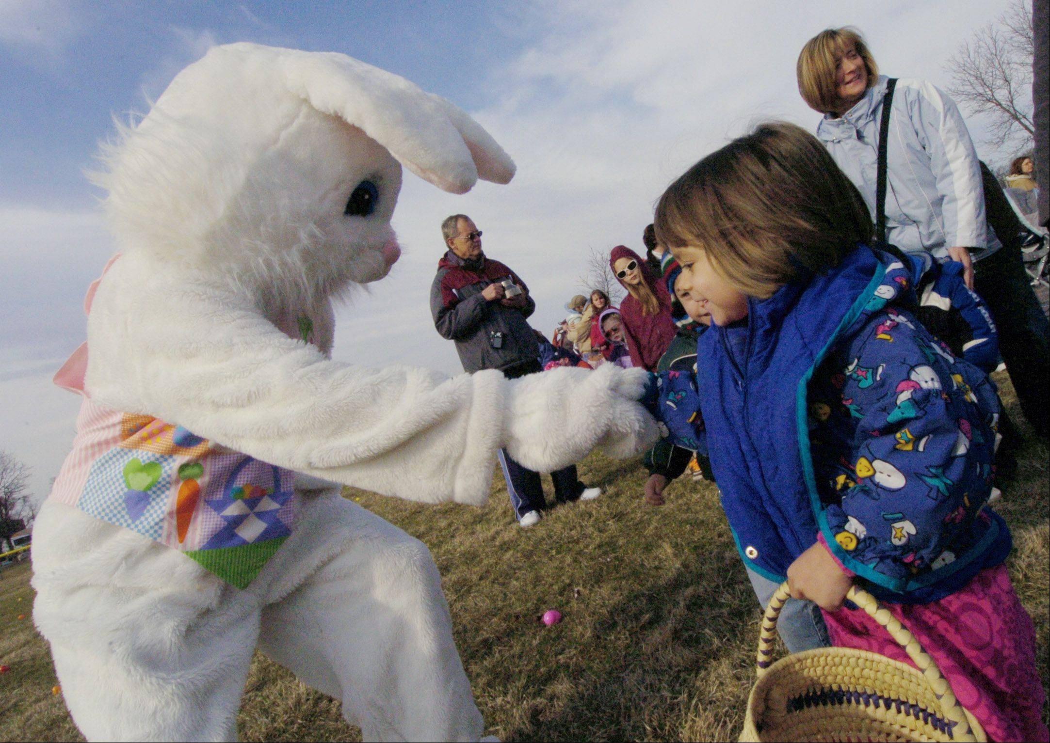 JOE LEWNARD/jlewnard@dailyherald.com, 2010The Easter bunny visits with children at Wauconda Park District's annual egg hunt at Cook Park in Wauconda.