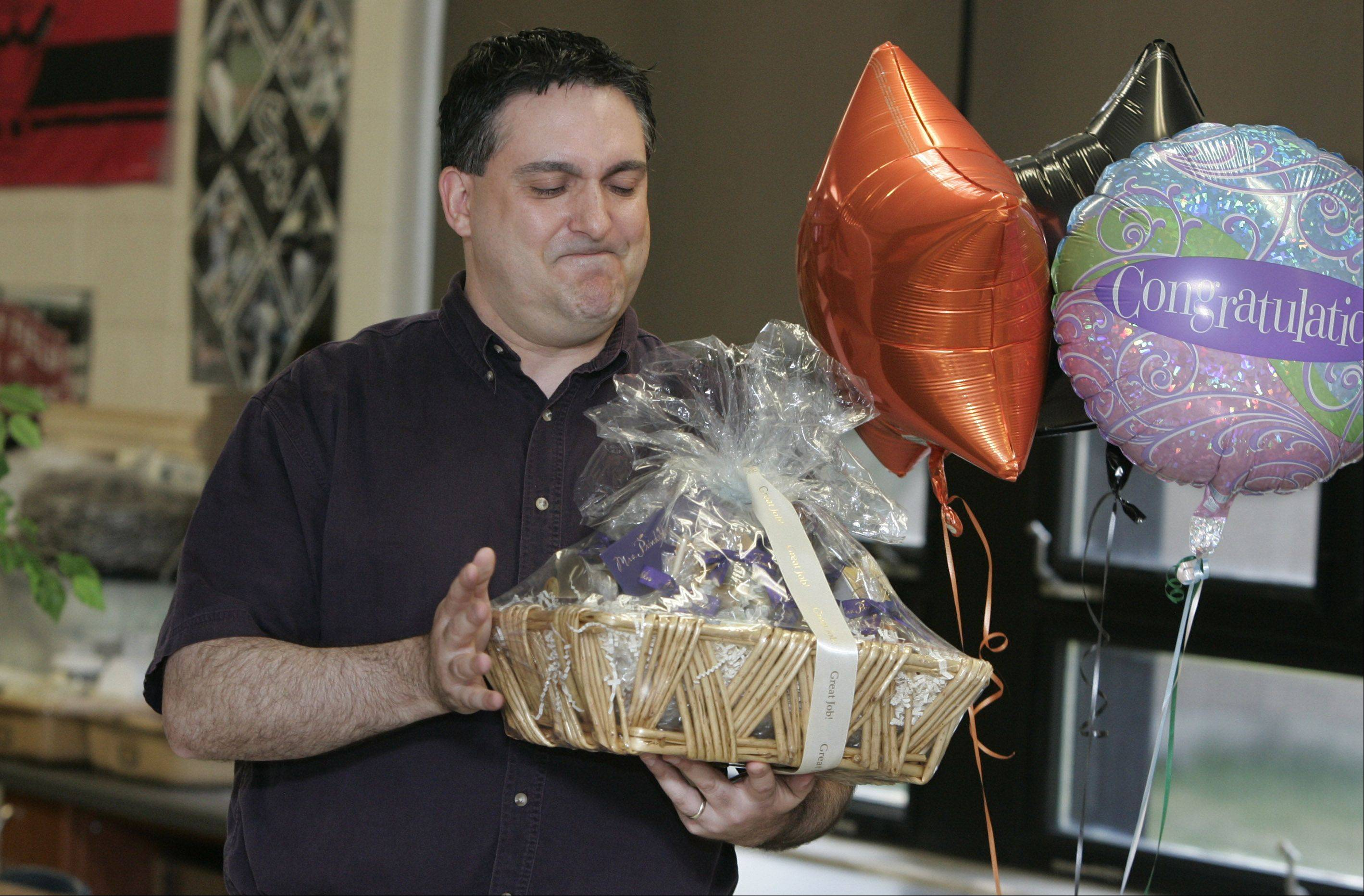Carl Sandburg Middle School science and technology teacher Michael Sementa was surprised in 2011 when he was awarded the Golden Apple Award at the Mundelein school.