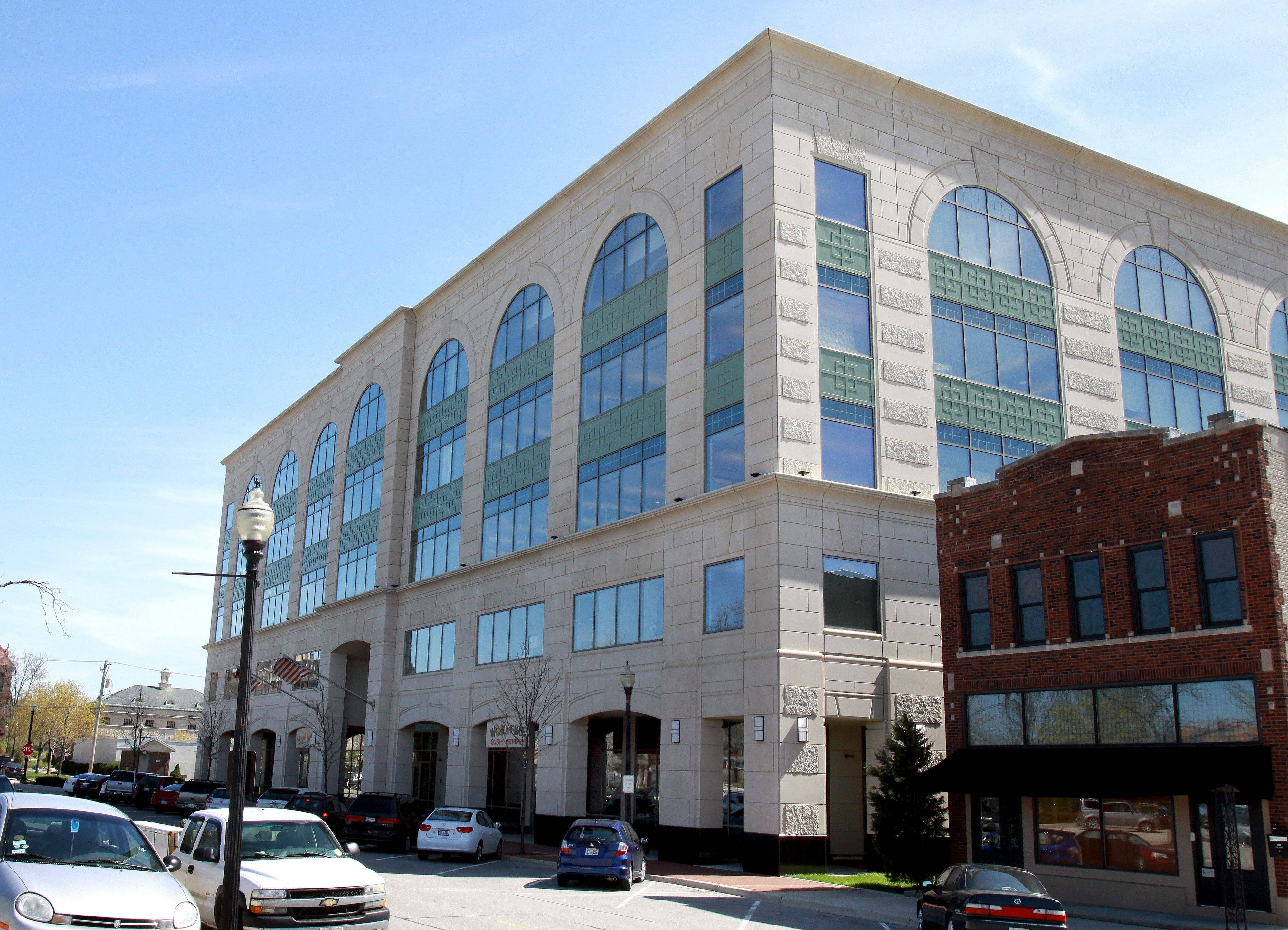 Milton Township and Wheaton are opposing a developer's effort to have a retail/office building in downtown reassessed. The five-story structure at 120 E. Liberty Drive generates hundreds of thousands of dollars annually for a special taxing district in Wheaton.