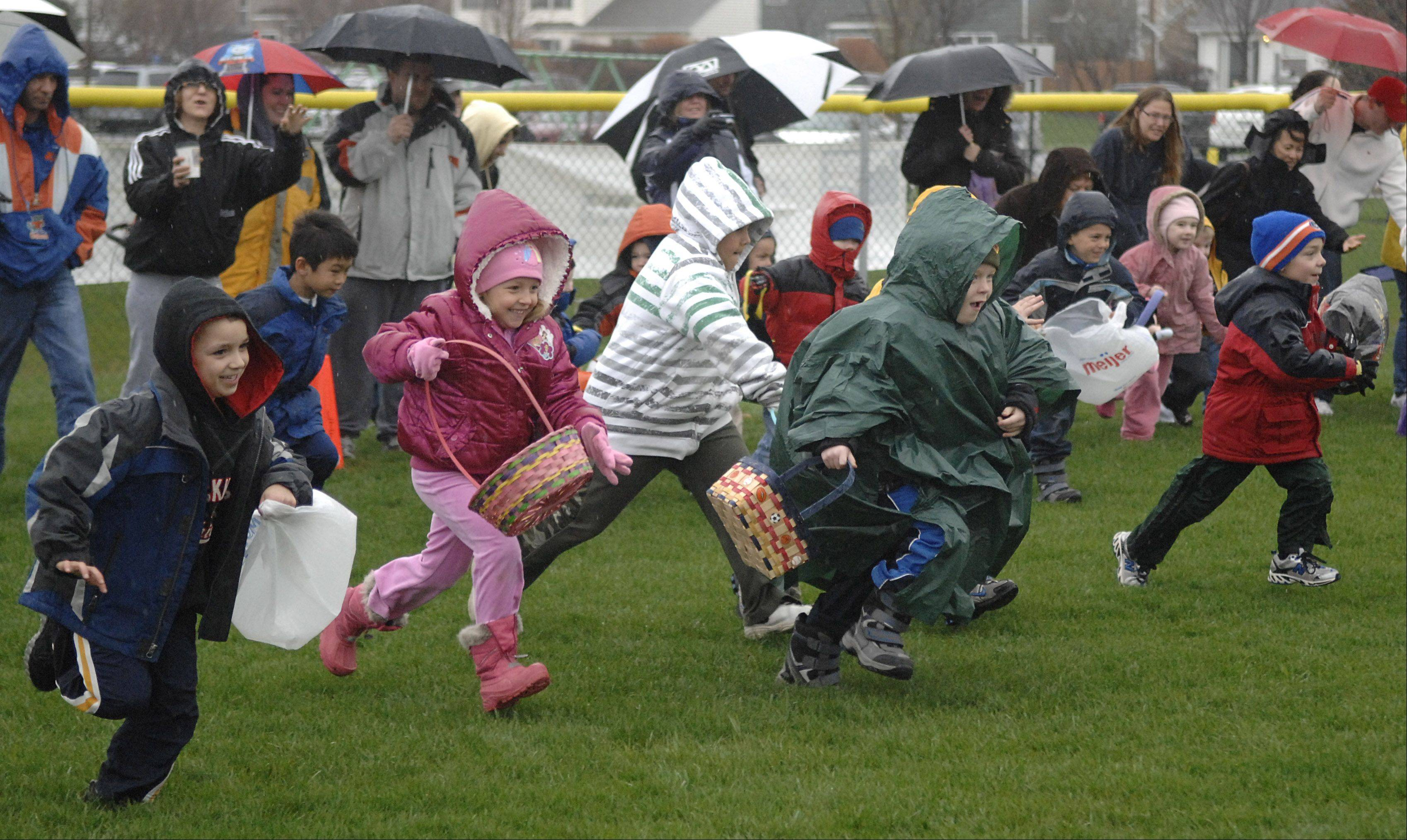 Children take off at 8 a.m. sharp to collect eggs and goodies at last year's Lake in the Hills Easter egg hunt.