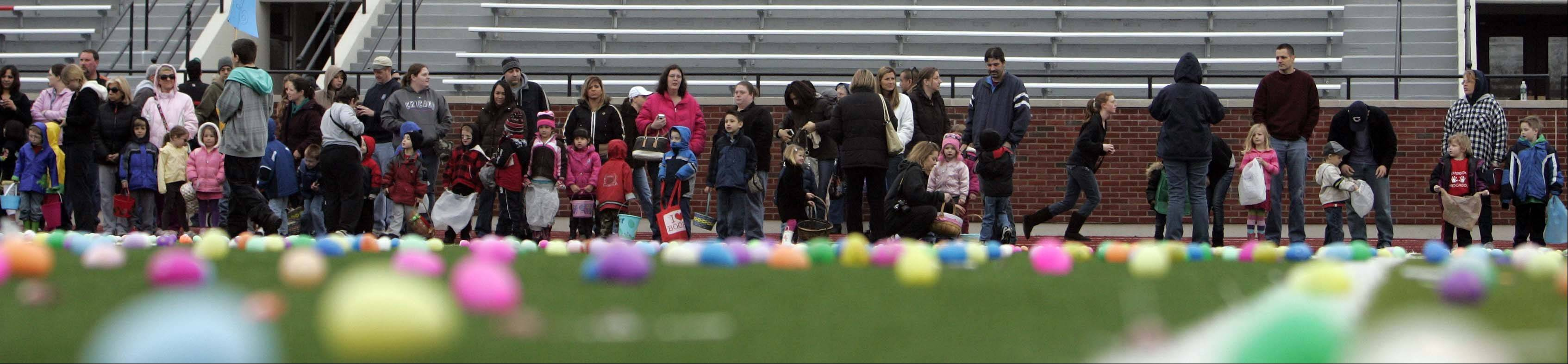 Participants line up as more than 6,000 plastics eggs greeted children during Mooseheart's Easter egg hunt last year.