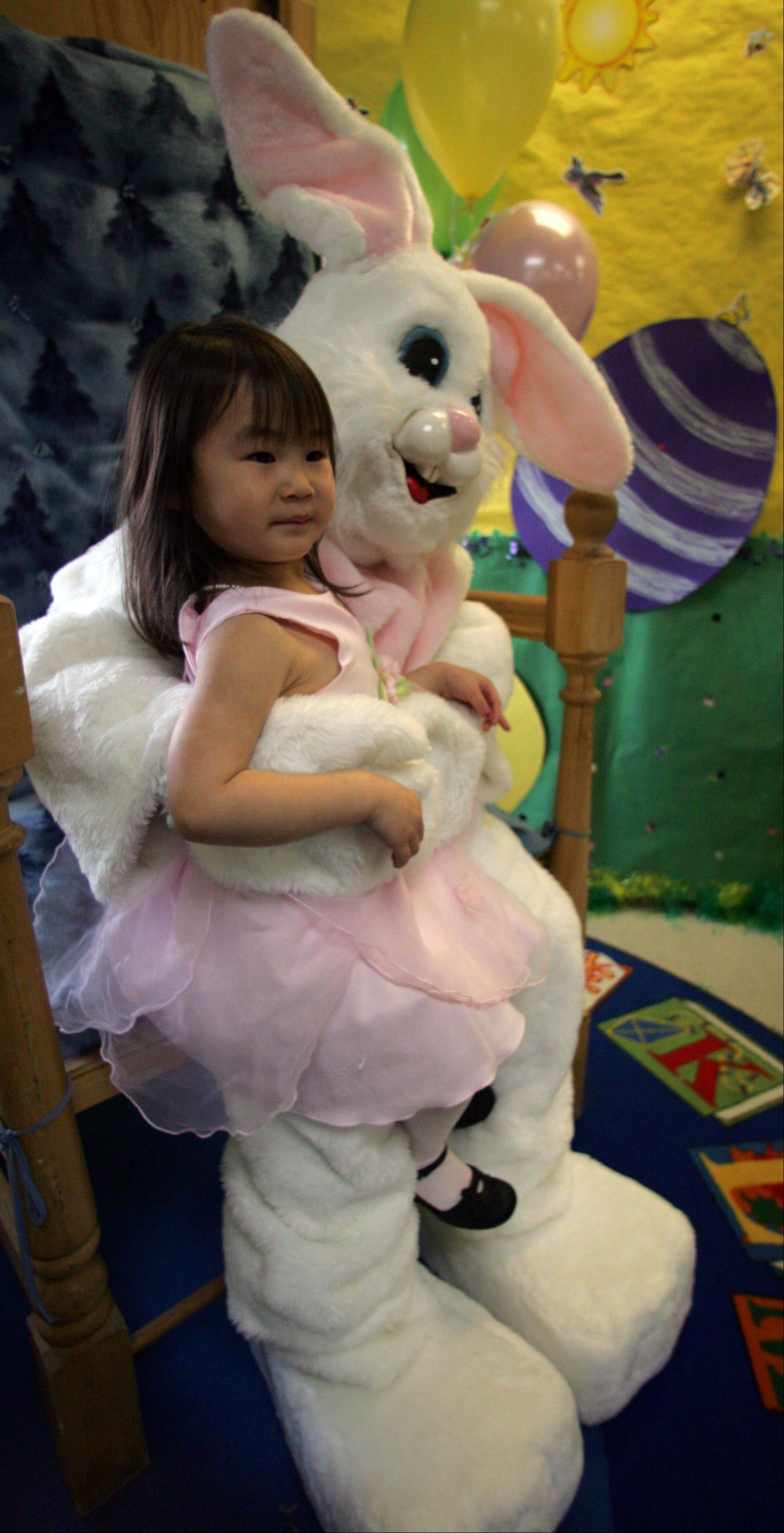 Katie Moore, 3, South Elgin, visits with the Easter Bunny, played by Lauren Alvarez, 16, Elgin, at a previous Breakfast with the Easter Bunny held by the South Elgin Parks and Recreation Department.