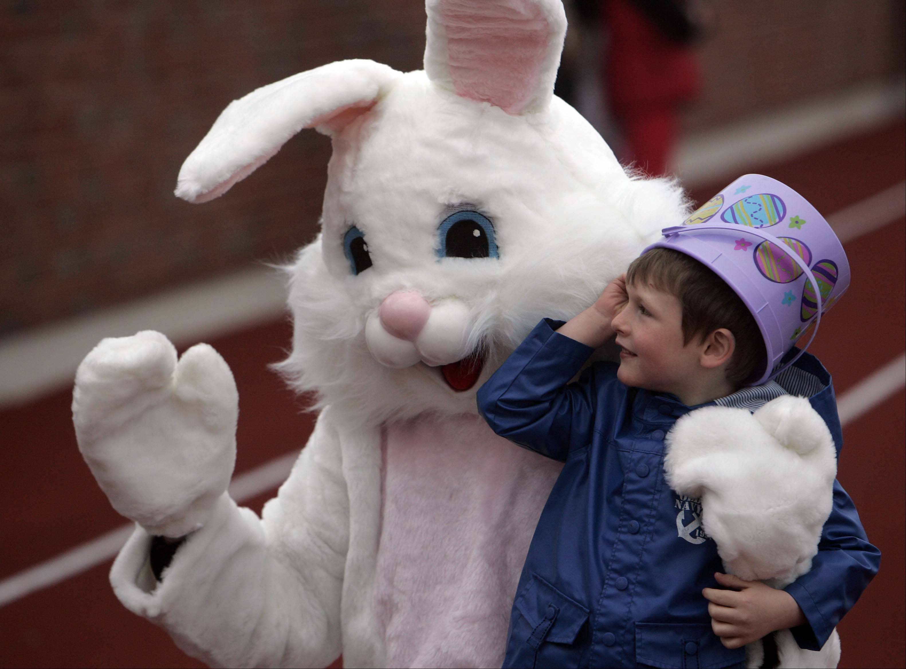 Five-year-old Michael Saupp of Lake Holiday gets a picture taken with the Easter Bunny prior to the egg hunt at Mooseheart last year.