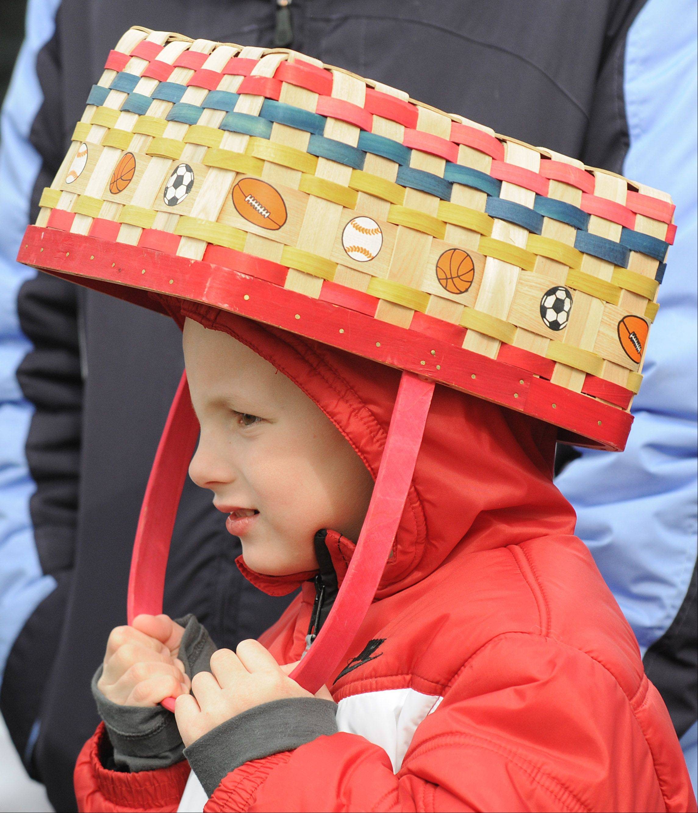 David Kimpel, 5, of Lake in the Hills, dons his basket while waiting for an Easter egg hunt in Algonquin.