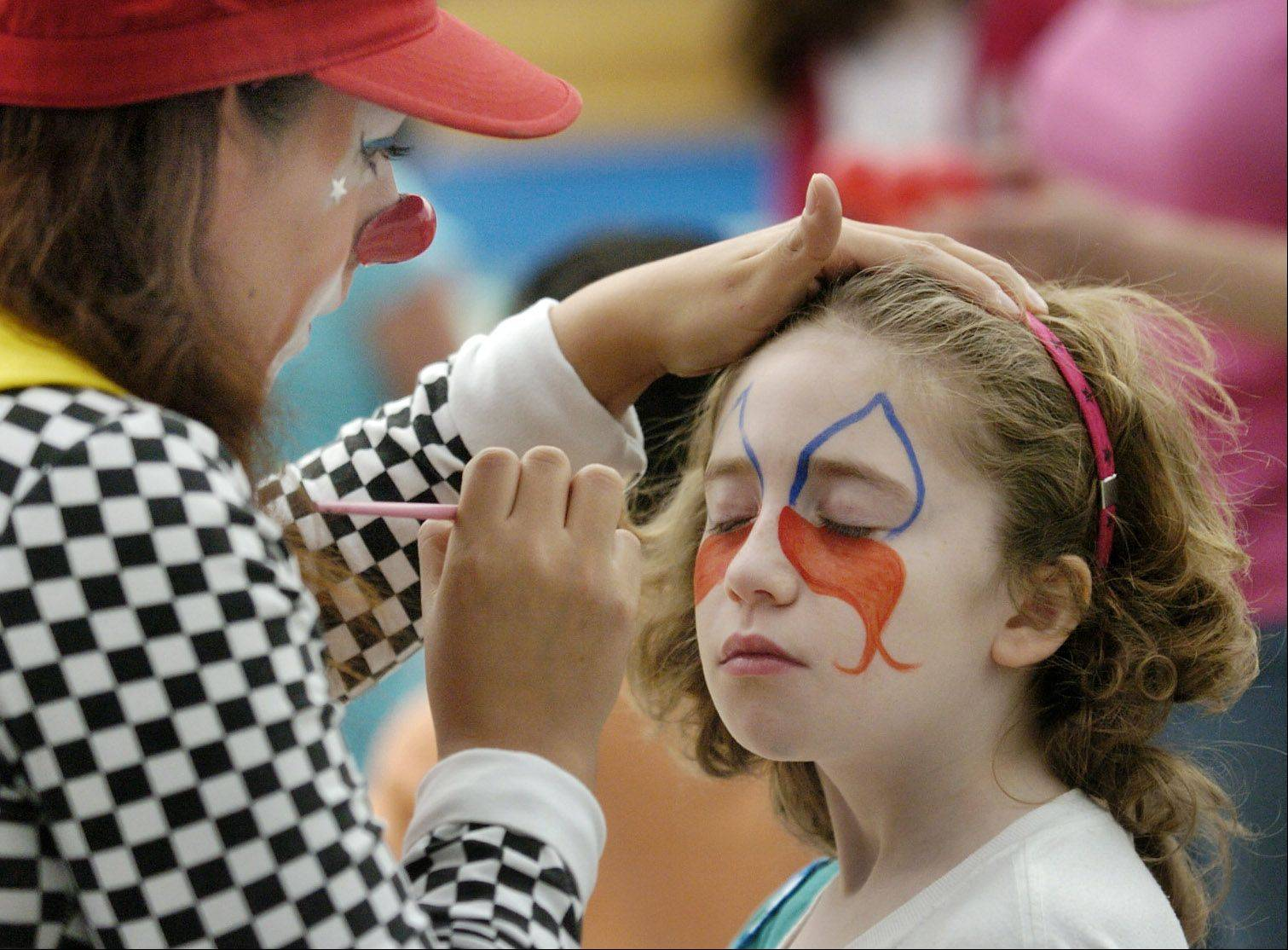 Alia Bongiorno, 11, gets her face painted by Ruth Flores of Clowns La Familia Flores during Hanover Park's 2010 Kids at Hope Coalition Foundation Days. This year's Kids at Hope Community Resource Fair is being held in conjunction with the village's 2nd Annual Hometown Seminar, both of which aim to connect residents with resources.