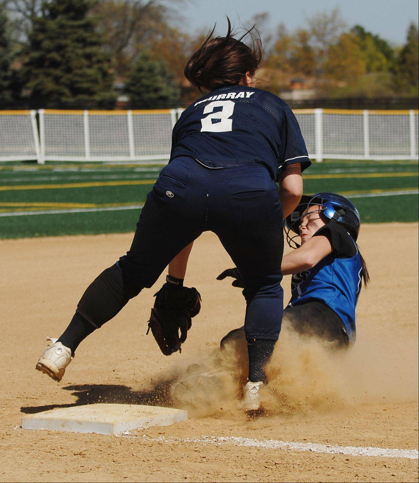 Bri Murray of Addison Trail,left, tags Lauren Rzeszutko of St. Francis during the St. Francis at Addison Trail softball game Wednesday.