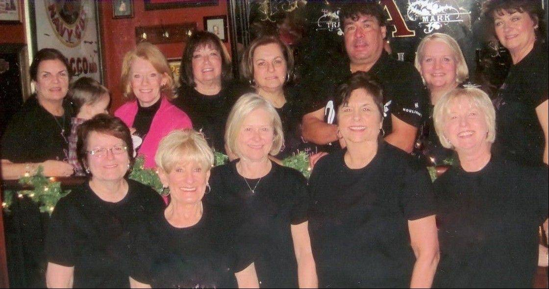 "Members of ""The Lunch Bunch"" at Houlihan's in Schaumburg. In the back row, from left, are Gail Scherer, Trina Toms, Sharon Forsberg, Pat Luciani, Manny their waiter, Kris Sypura and Mary Michonski. In the front row are Sue Happ, Martie Roehm, Linda Meece, Diane Cerilli and Karen Gaul."