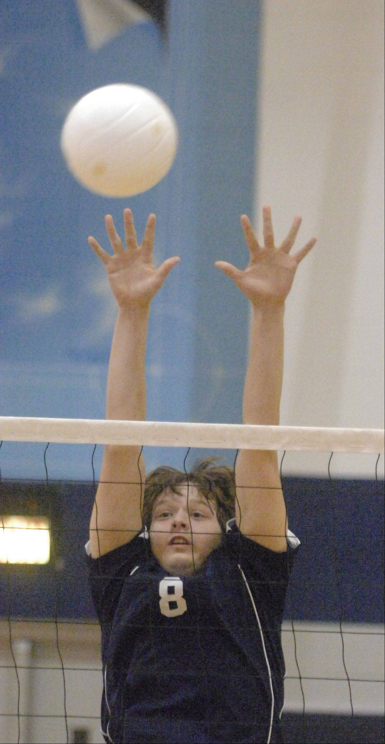 Paul Michna/pmichna@dailyherald.com Gus MacPherson of West Chicago goes up for a block during the Fenton at West Chicago boys volleyball game Tuesday in West Chicago.