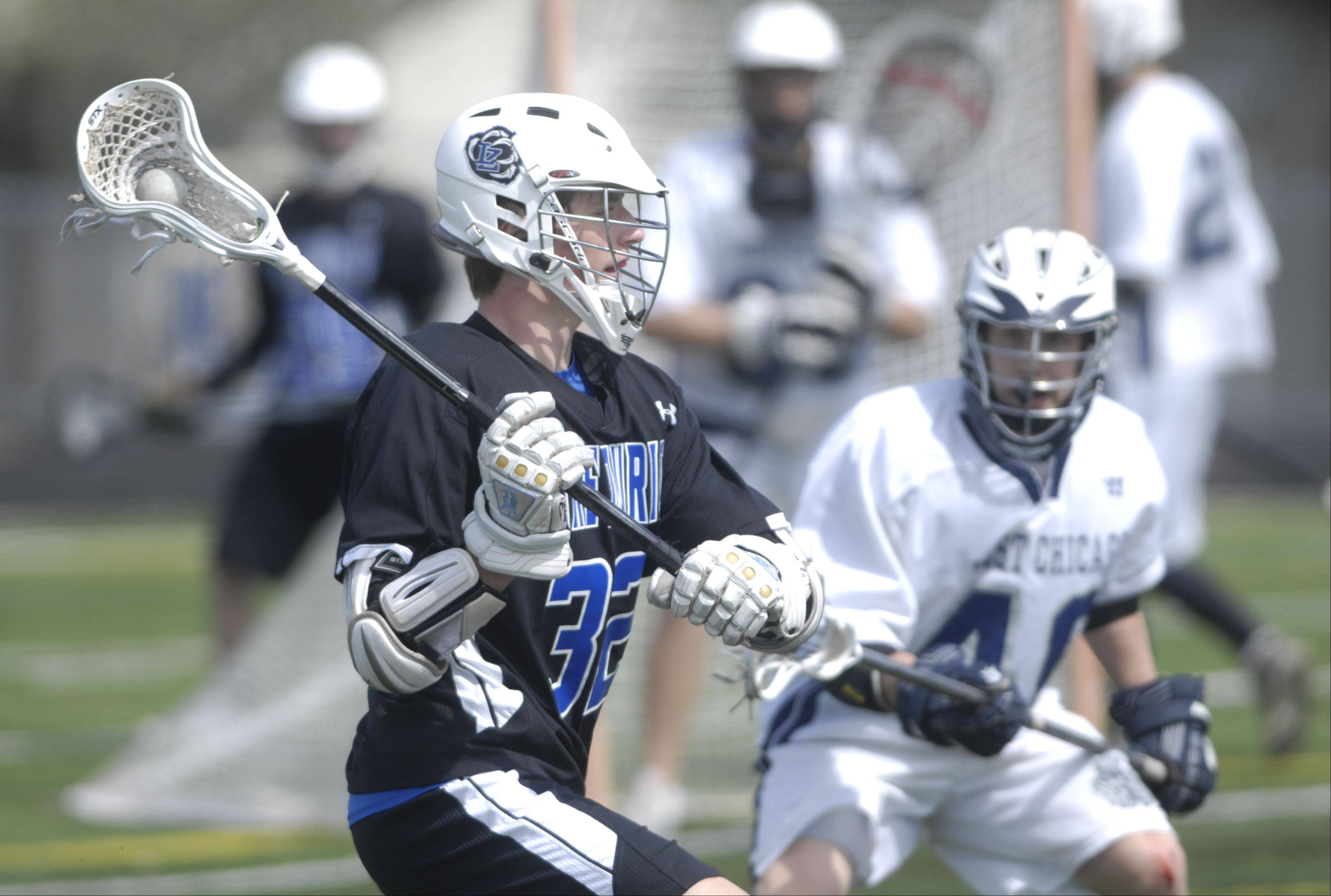 Images from the West Chicago vs. Lake Zurich boys lacrosse match at Hoffman Estates on Thursday, March 29, 2012.