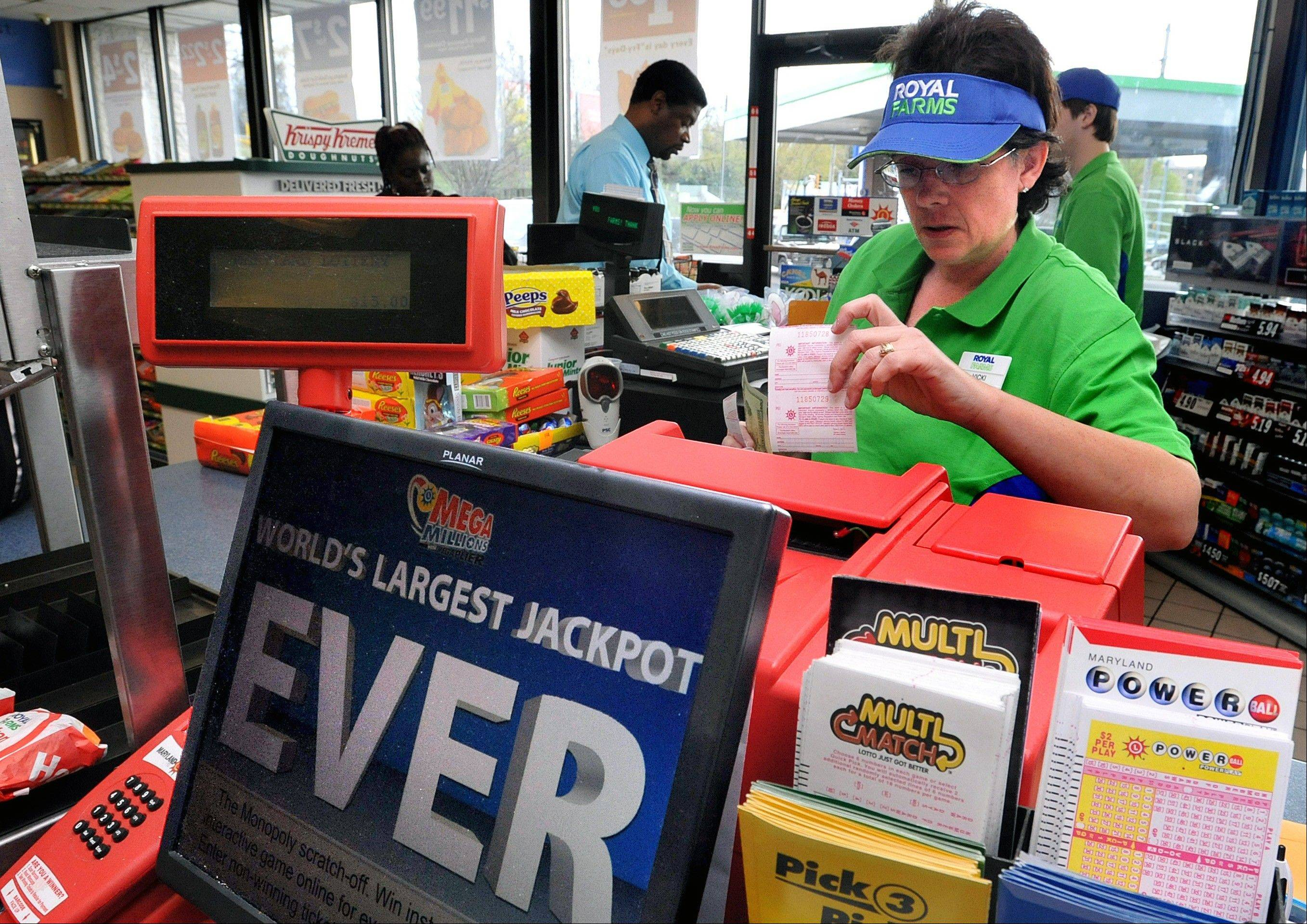 Vicki Sharples sells a Mega Millions lottery ticket Friday at the Royal Farms in Salisbury, Md.