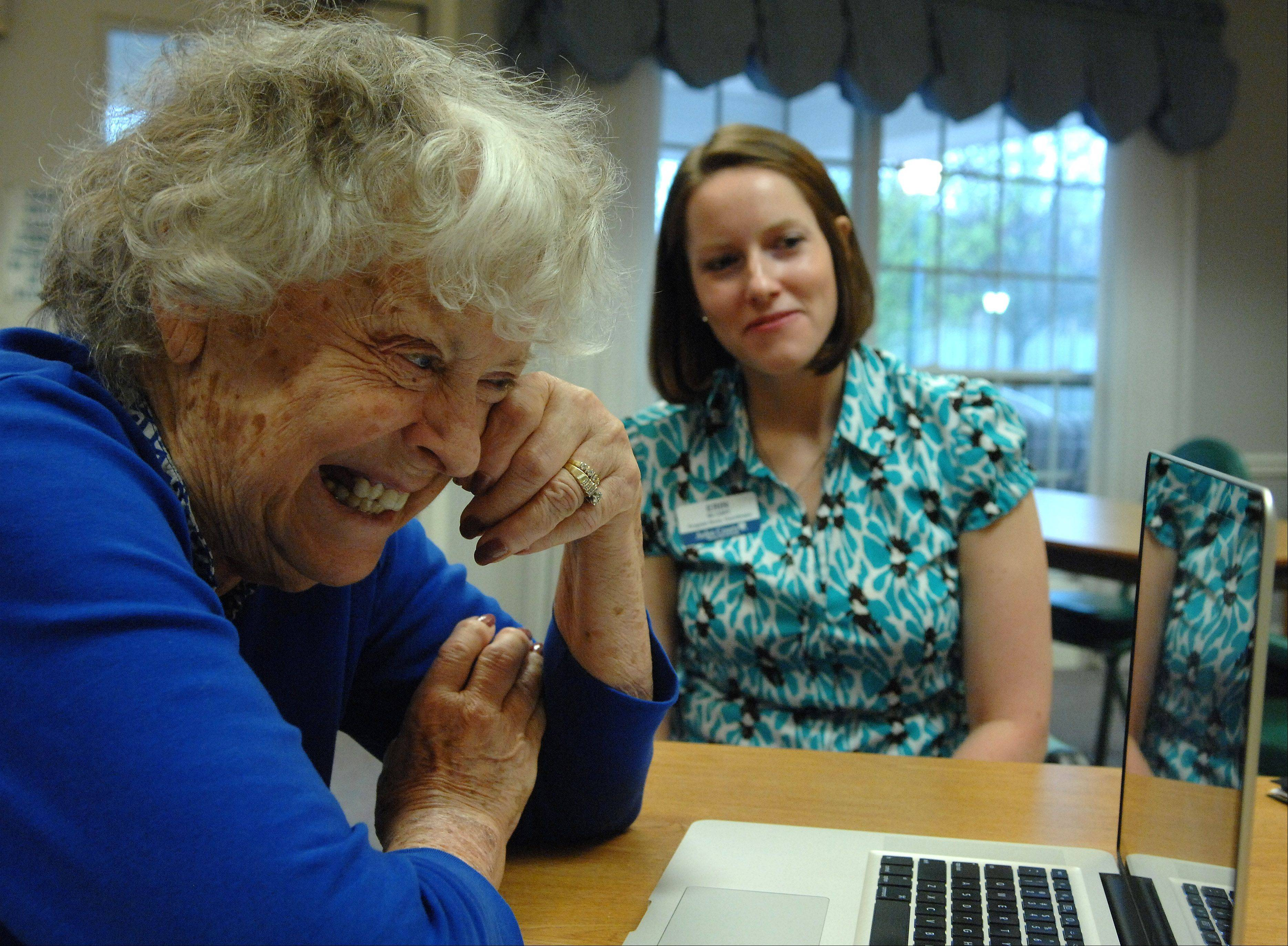 Arden Courts Memory Care resident Janie Smals wipes away a tear while she Skypes with her daughter in Florida as Erin McCart looks on. McCart set up weekly meetings so Smals could connect with her daughter and grandkids.