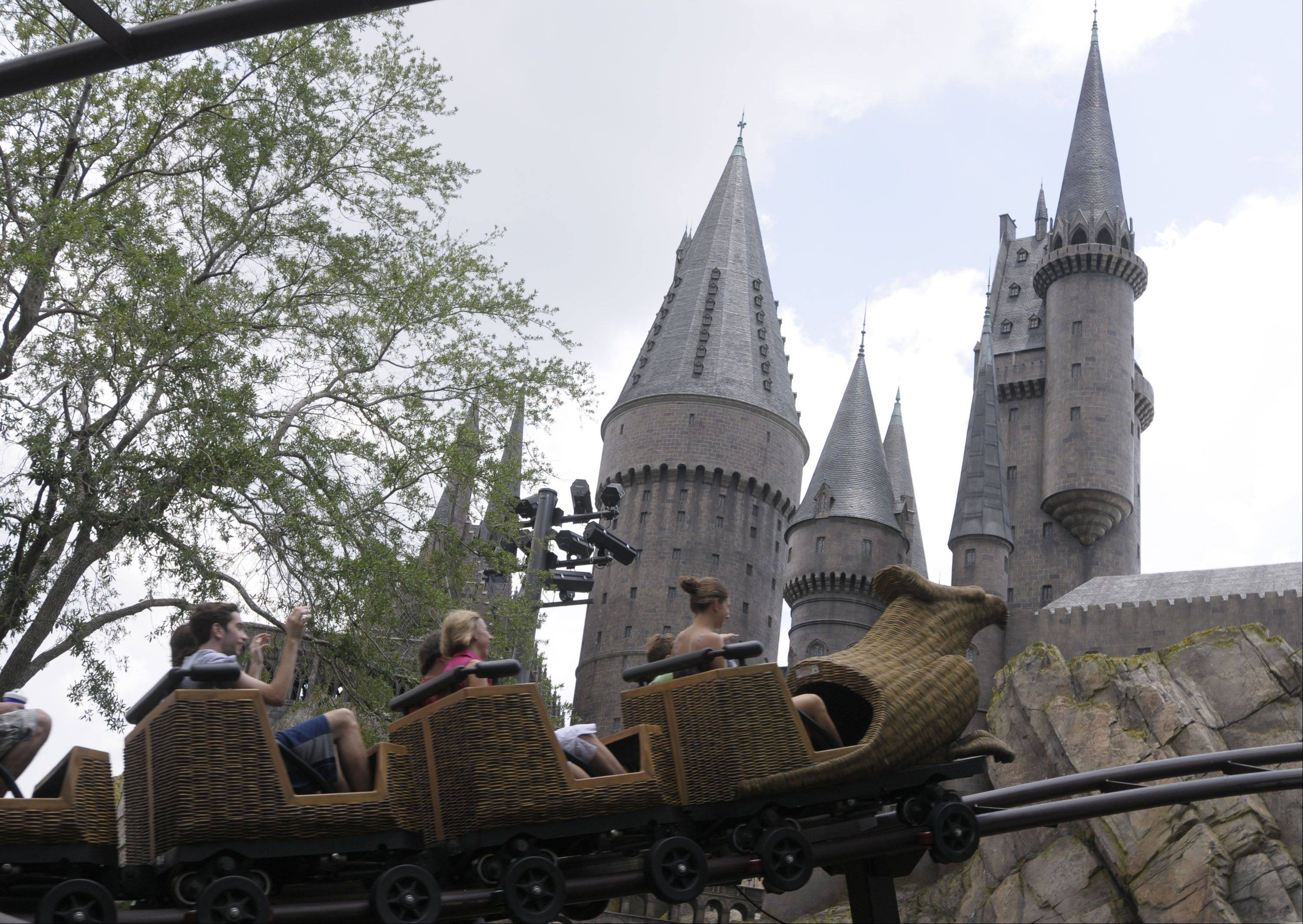 Guests ride on the Flight of the Hippogriff past Hogwarts castle at Universal Studios' Wizarding World of Harry Potter in Orlando, Fla., a popular spring break destination for suburban families.