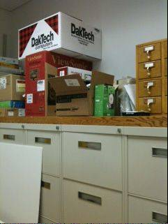 The Ella Johnson Public Library in Hampshire is running out of room for storage. These boxes and others like them have found a home in the library director's office.