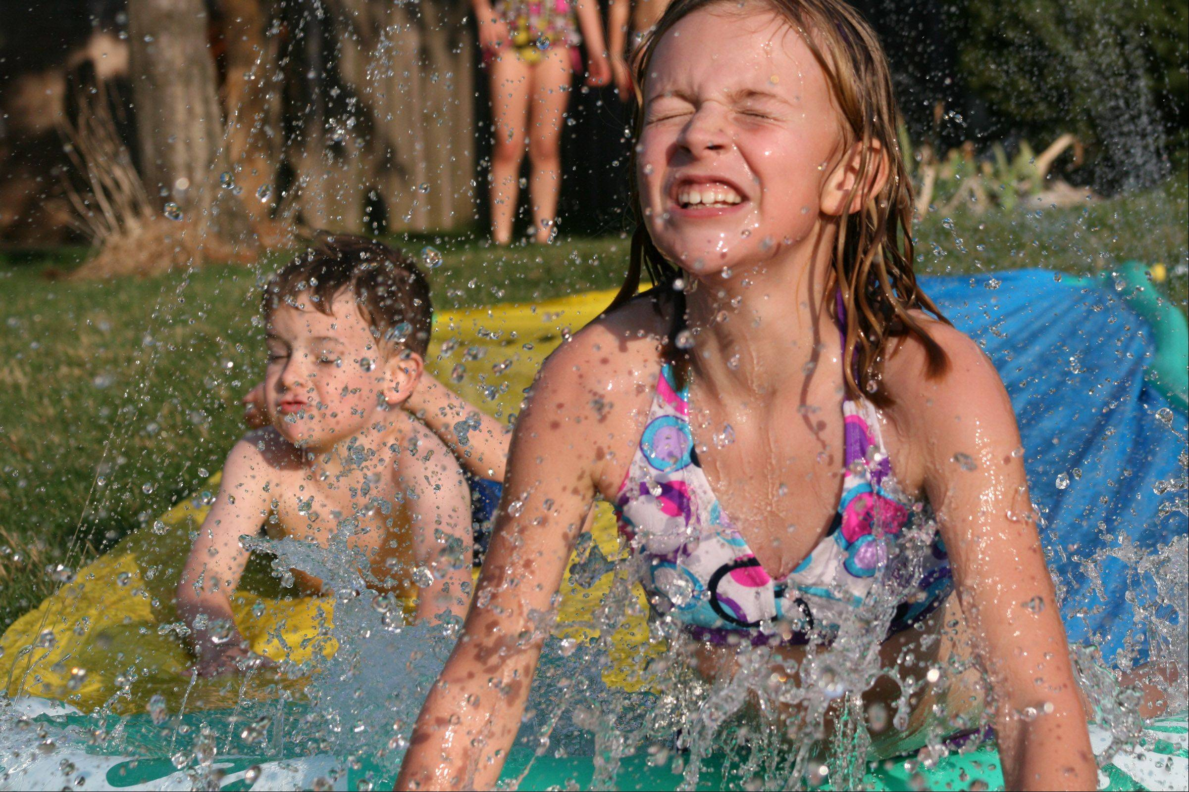 With all the warm weather we've been having, the neighborhood kids got their slip and slide out. They all have such fun on March 18, 20012 in Cary in their bathing suits! Who would of thought!