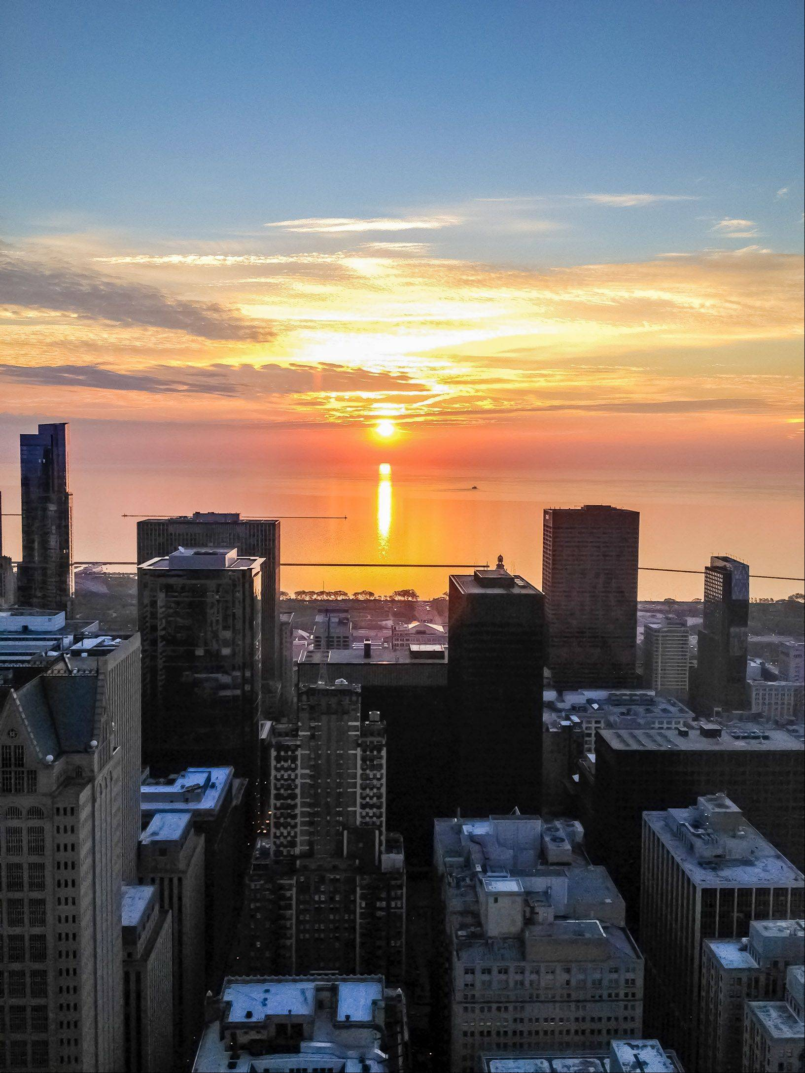 Photo was taken from the Willis Tower on Thursday AM. It shows the sun rising over Lake Michigan.