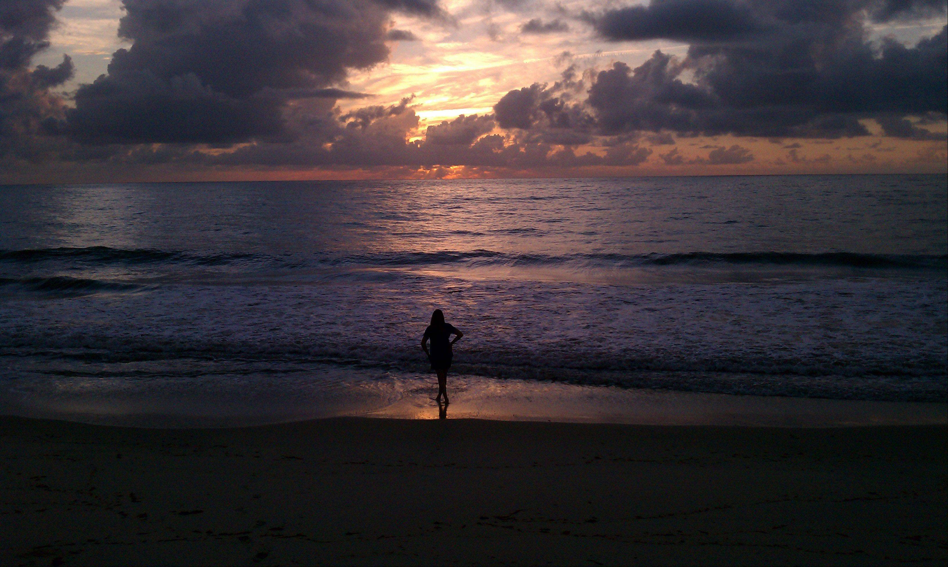 After driving straight through from the Fox Valley to Vero Beach, Florida, my wife and I arrived at South Beach at about 6 a.m. The sun had just come up and it was gorgeous. My wife made it to the water's edge first totally immersed in the moment and I took the picture.