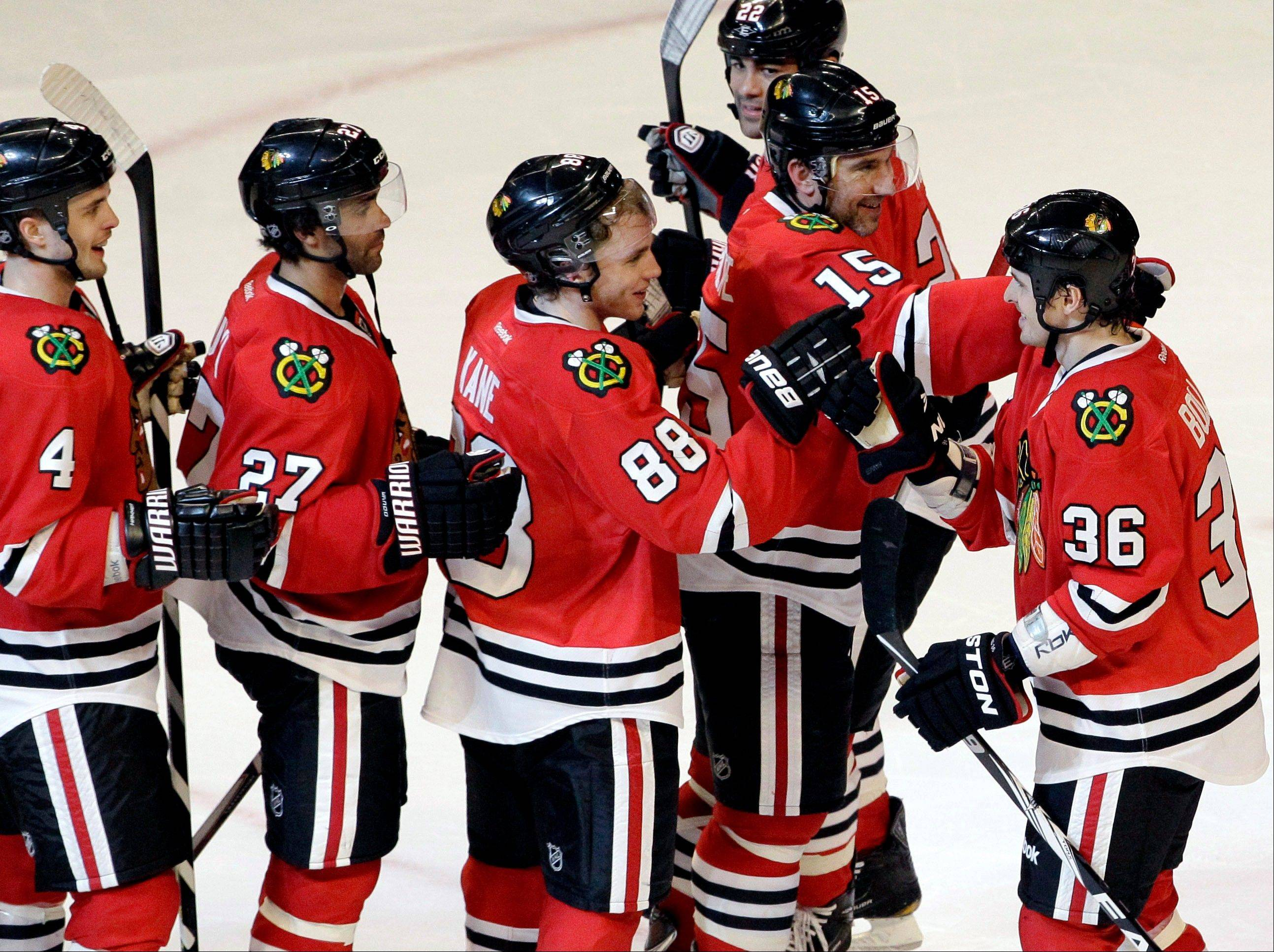 The Blackhawks' Dave Bolland (36) greets teammates Thursday night after his shootout goal defeated the Blues at the United Center.