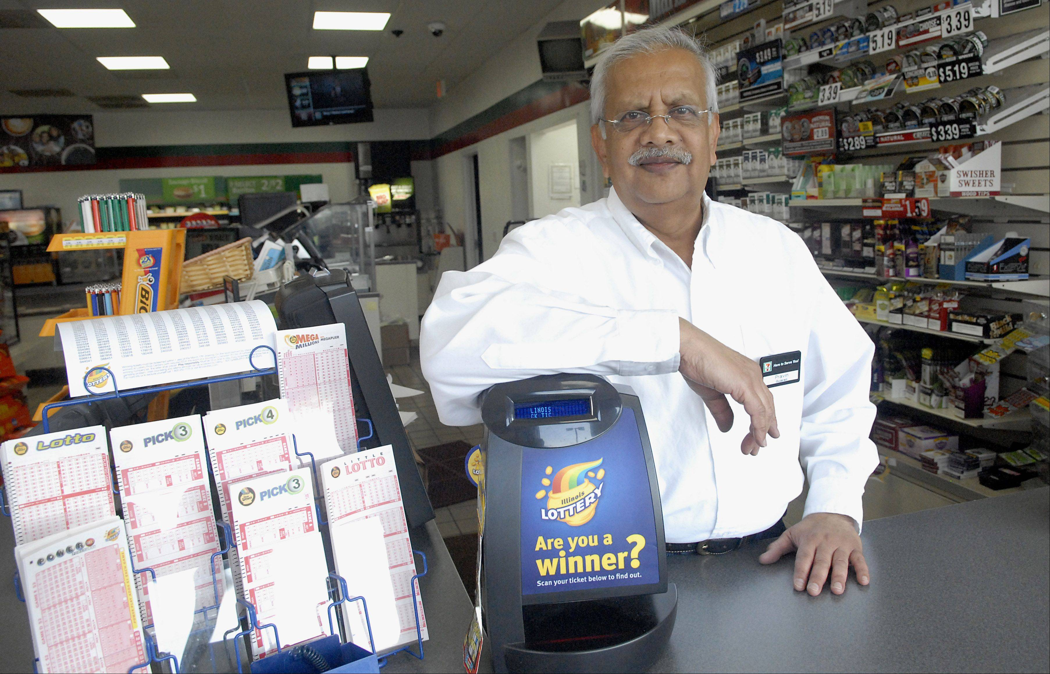 Laura Stoecker/lstoecker@dailyherald.comA $250,000 Mega Millions winning ticket was purchased at the 7-11 at 305 N. Barrington Rd in Streamwood owned by Pravin Patel. Patel isn't sure who the winner is yet.