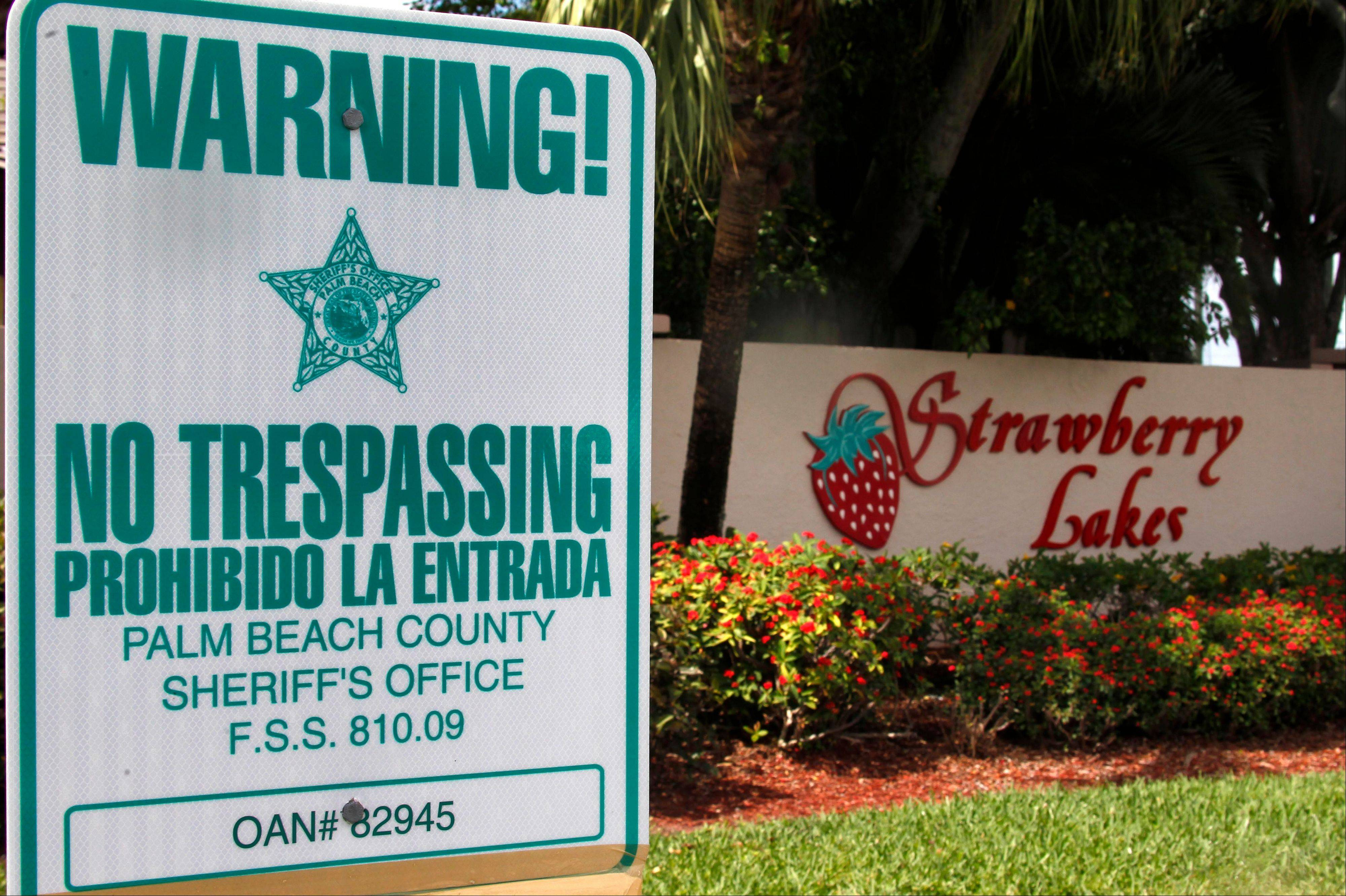 "A ""No Trespassing"" sign is shown in front a neighborhood of 262 homes called Strawberry Lakes, in Lake Worth, Fla. Thrashed by the mortgage and foreclosure disaster, Florida has thousands of distressed properties. But figuring out just how many is not so simple. Each month, analysts issue reports detailing the number of homes nationwide in foreclosure or held by banks. The implication is that if we can just find a cure for these loans and homes, either by matching buyers with houses or helping the borrowers stay put , the economy will at last be able to heal."