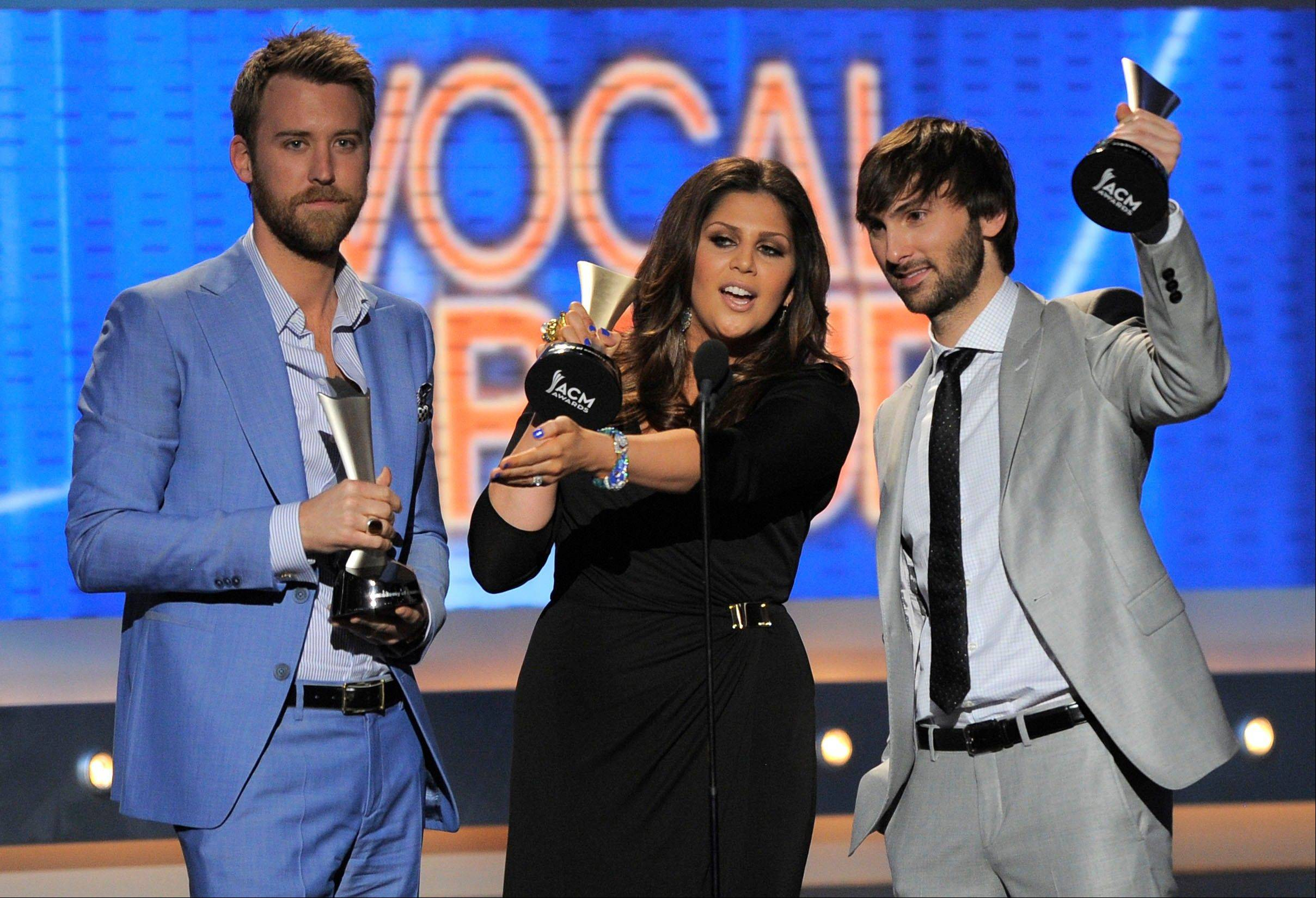 Charles Kelley, left, Hillary Scott and Dave Haywood of Lady Antebellum accept the award for vocal group of the year.