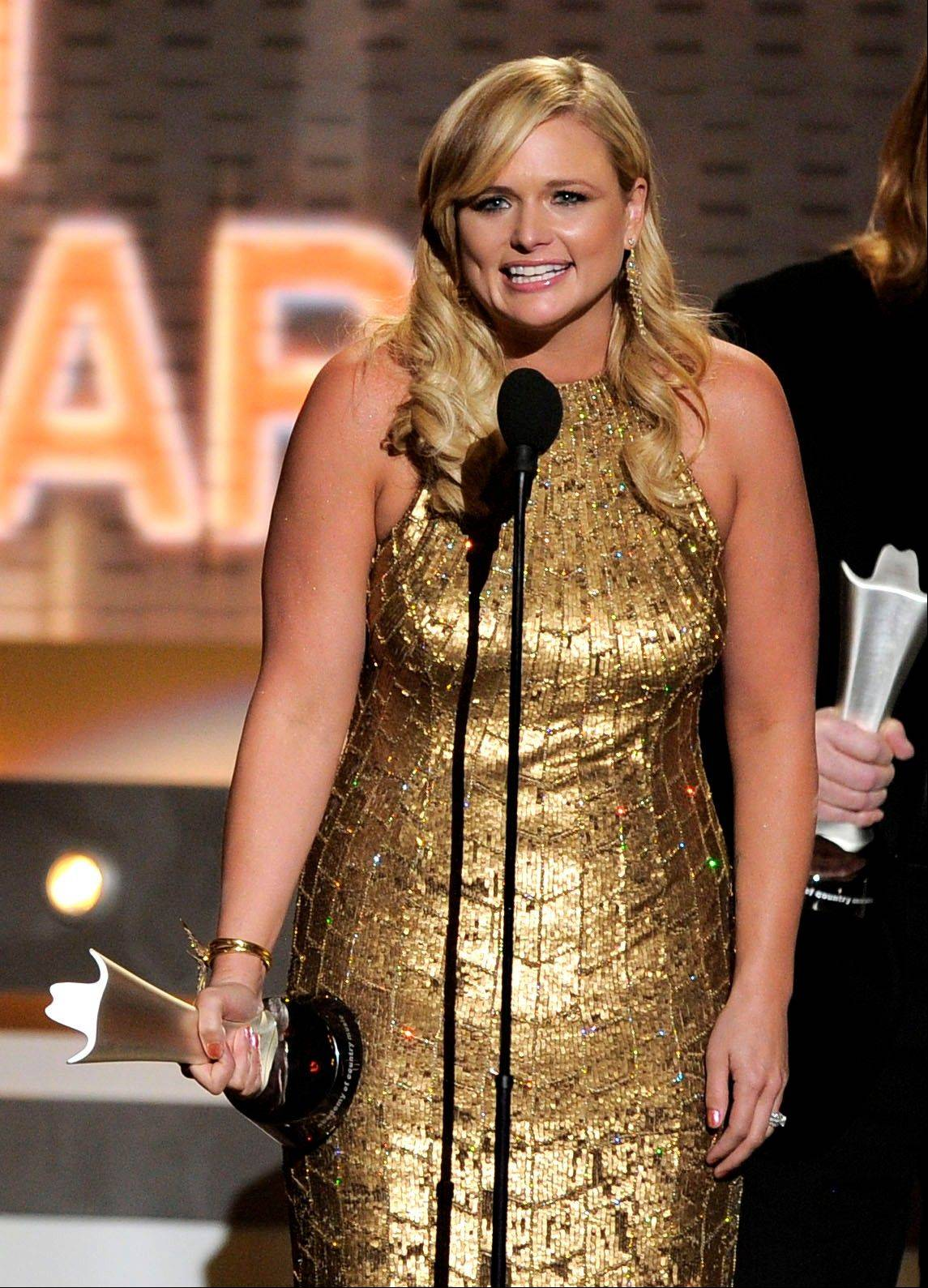 "Miranda Lambert accepts the award for album of the year for ""Four the Record."" Lambert would go on to win female vocalist of the year."