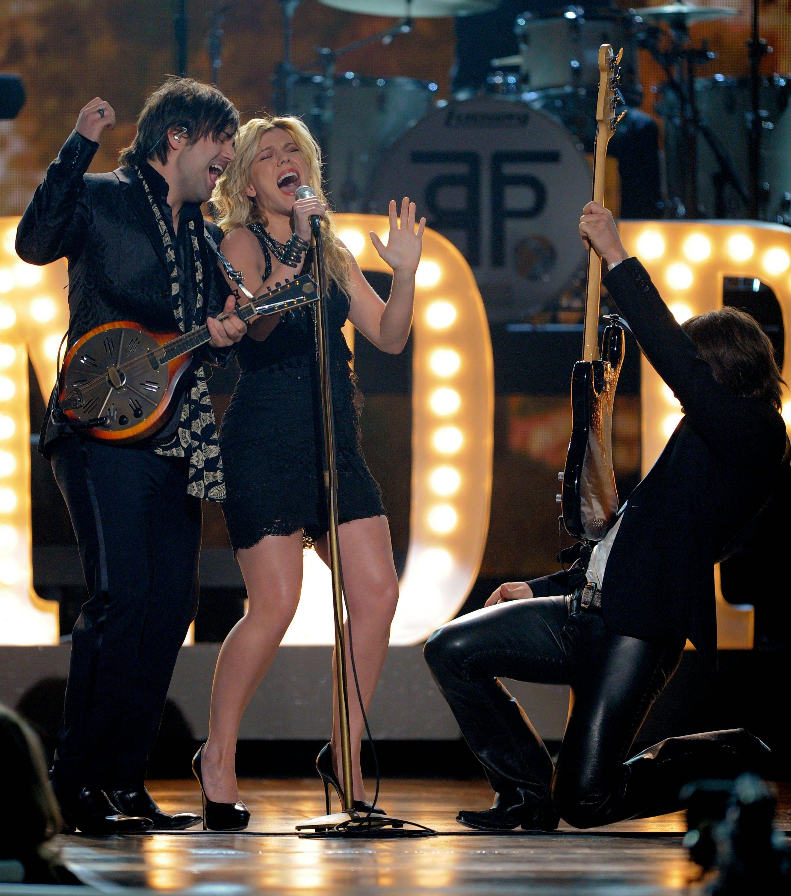 From left, Neil Perry, Kimberly Perry and Reid Perry, of musical group The Band Perry, perform at the 47th Annual Academy of Country Music Awards.