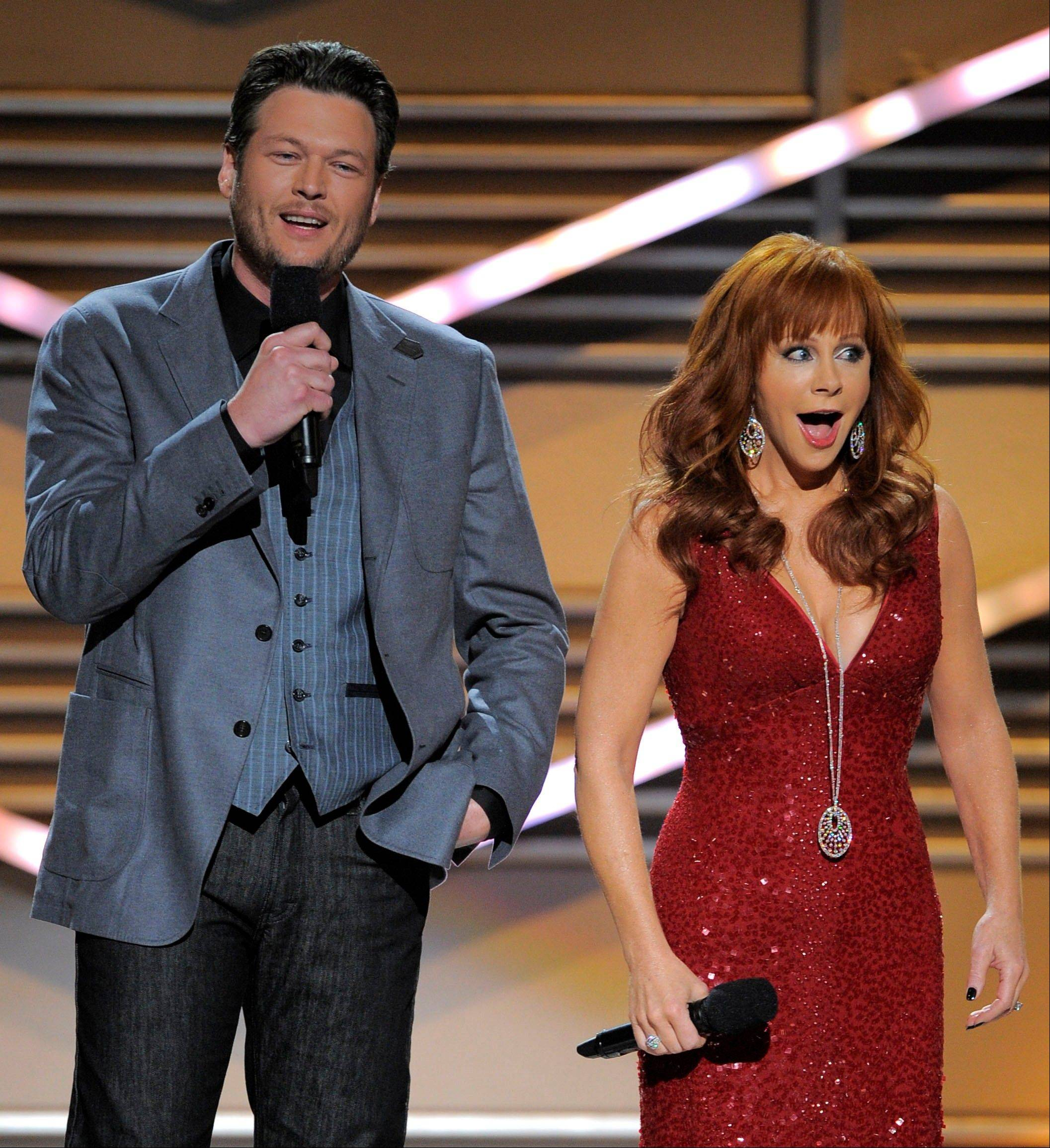 Hosts Blake Shelton and Reba McEntire have a little fun onstage at the 47th Annual Academy of Country Music Awards on Sunday in Las Vegas. Shelton would go on to win male vocalist of the year.