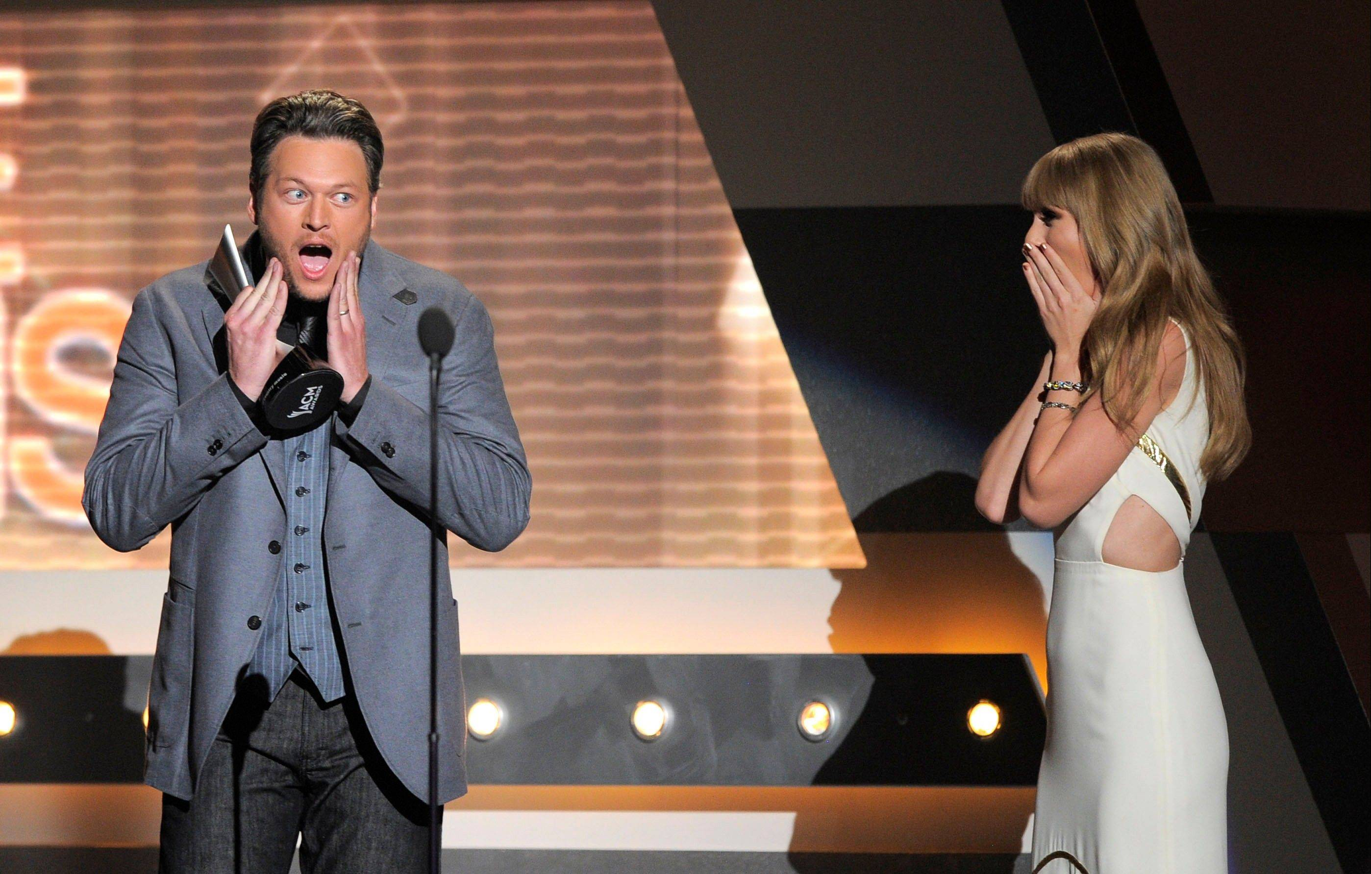 Taylor Swift, right, presents the award for male vocalist of the year to Blake Shelton at the 47th Annual Academy of Country Music Awards on Sunday in Las Vegas. Swift would grab an award of her own, beating out Shelton and a few others for enterainer of the year.