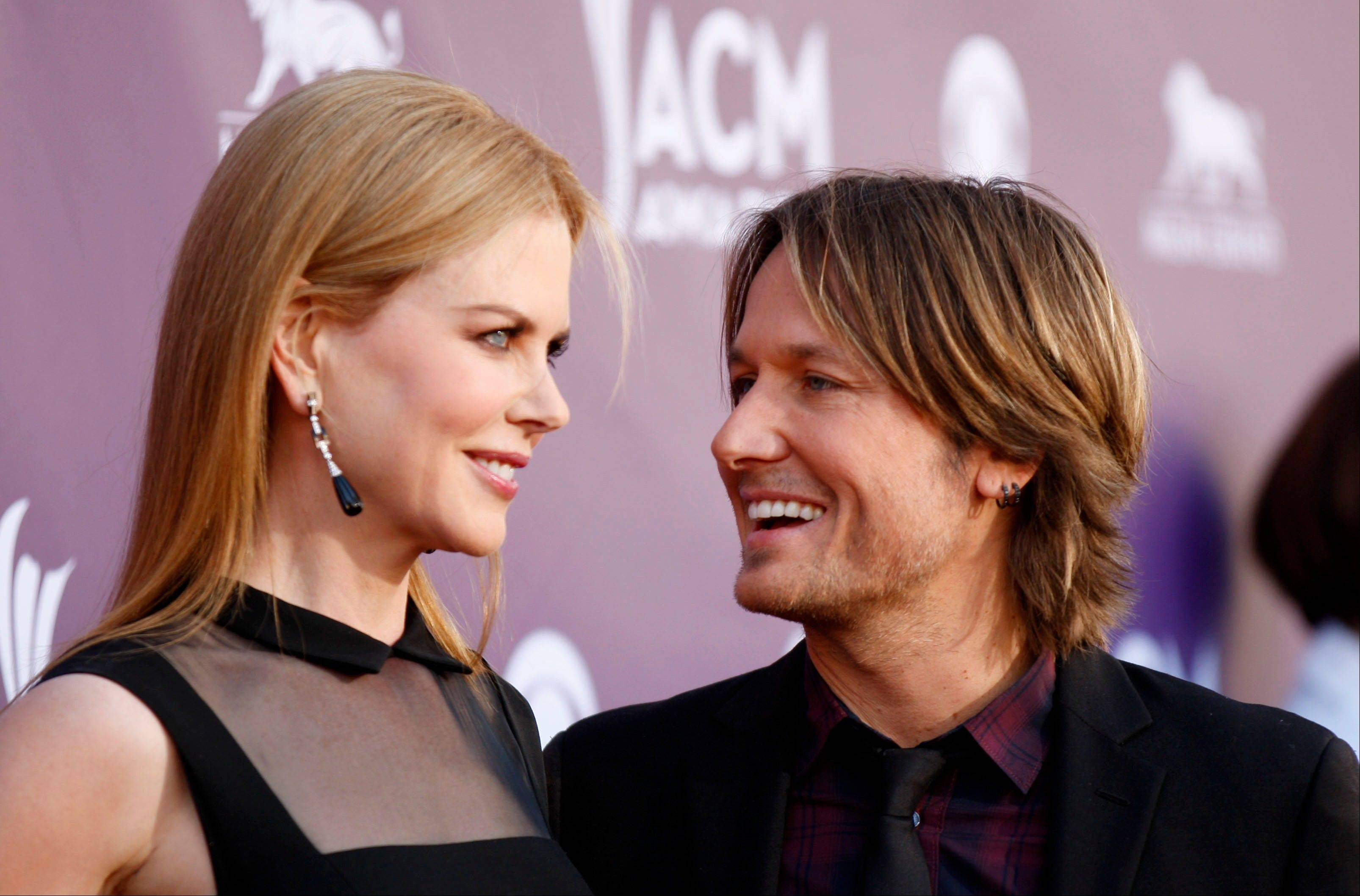 Nicole Kidman and Keith Urban are all smiles as they make their way into the ceremony Sunday.