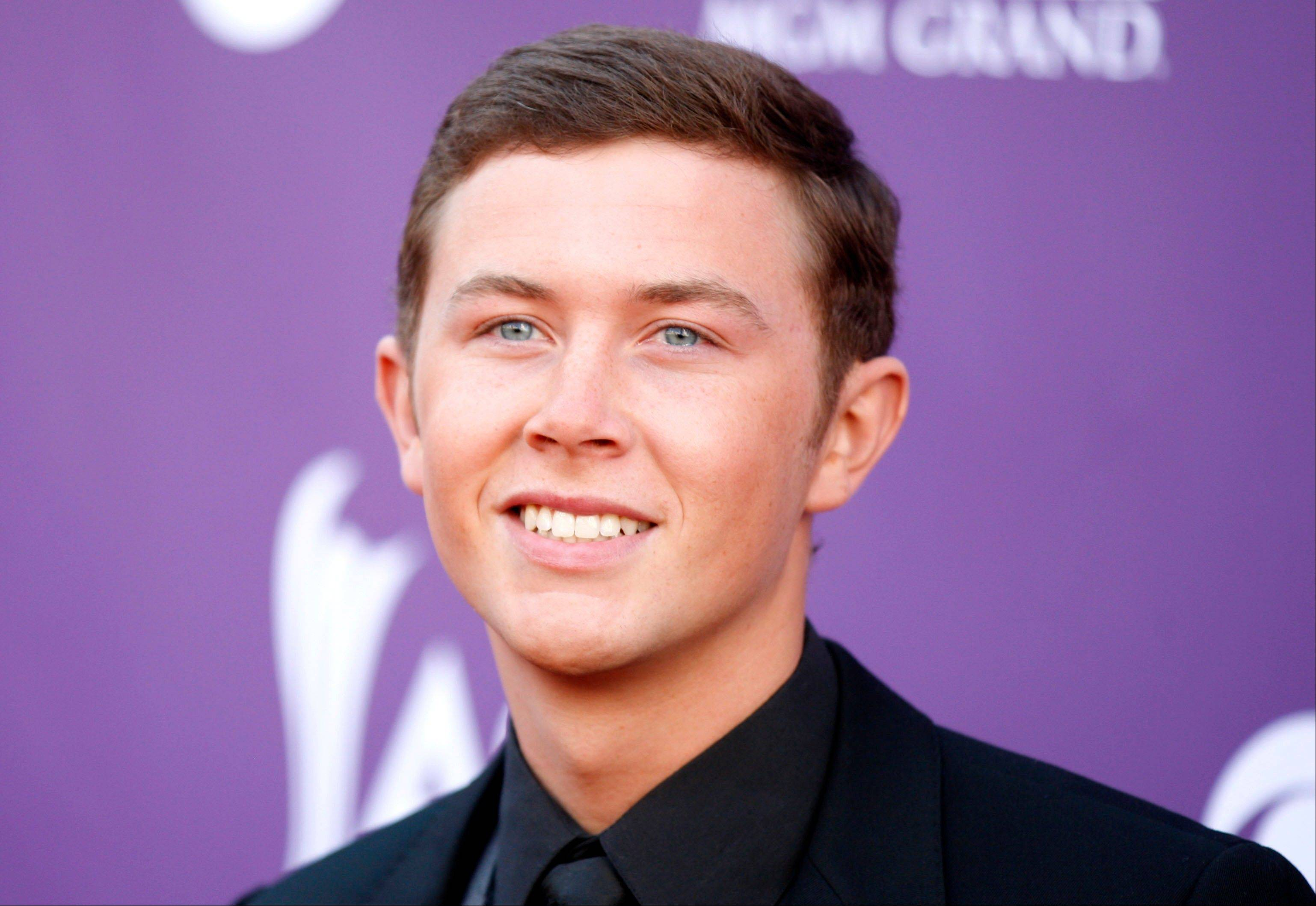 "Last year's ""American Idol"" winner Scotty McCreery arrives at the 47th Annual Academy of Country Music Awards on Sunday in Las Vegas."