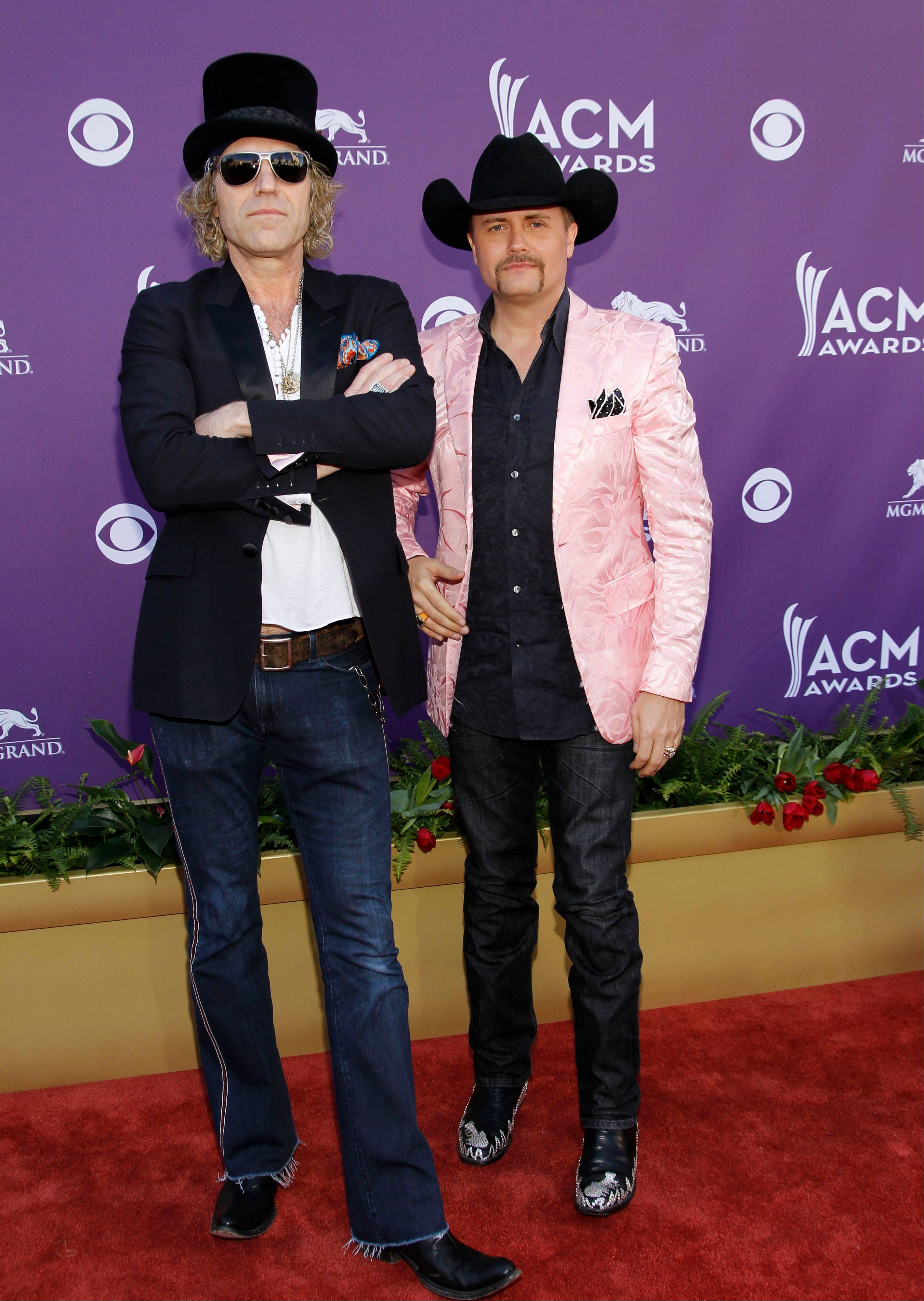 Big Kenny, left, John Rich, of musical group Big and Rich, had a little fun goofing around on the red carpet.