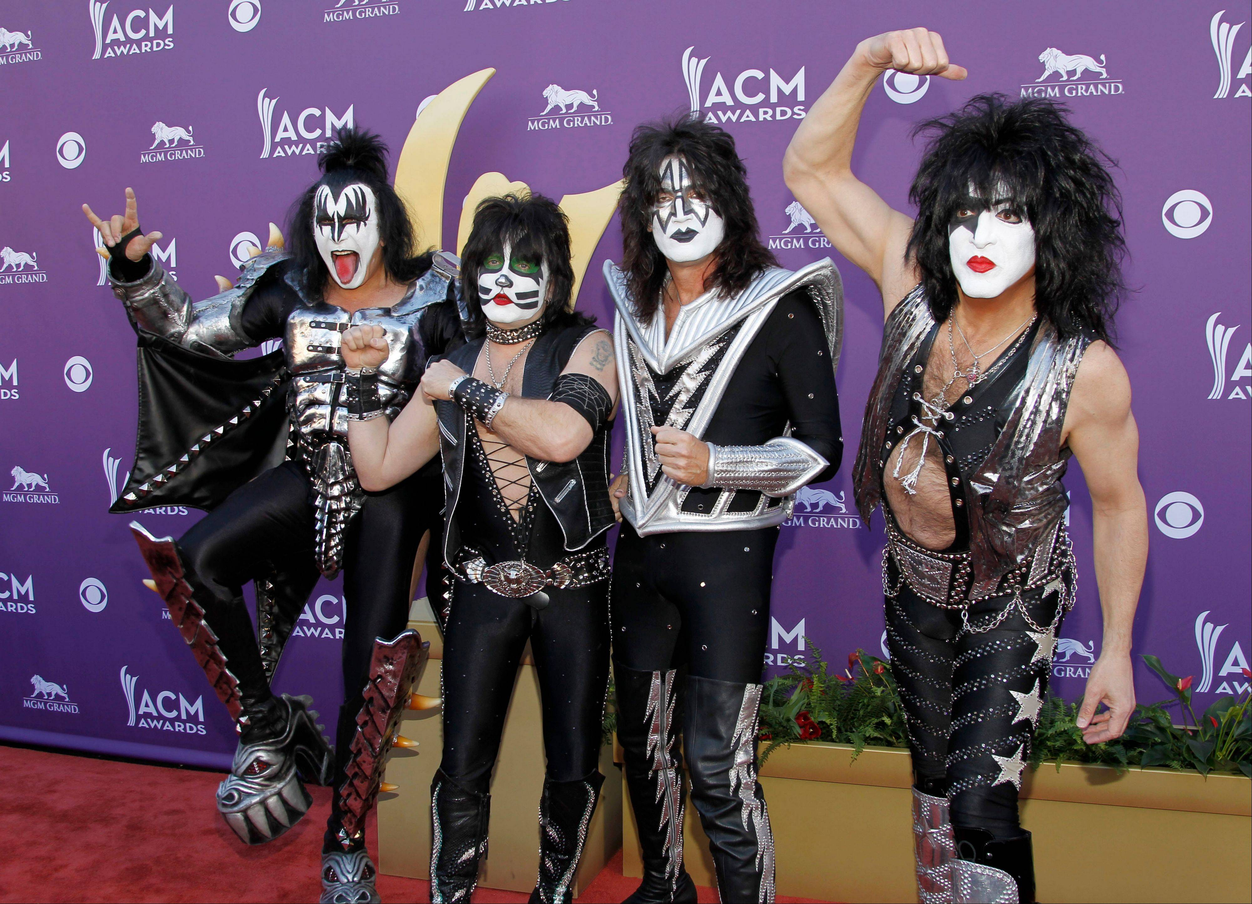 Yes, it's KISS at the Academy of Country Music Awards. From left, Gene Simmons, Eric Singer, Tommy Thayer and Paul Stanley, have some fun along the red carpet.