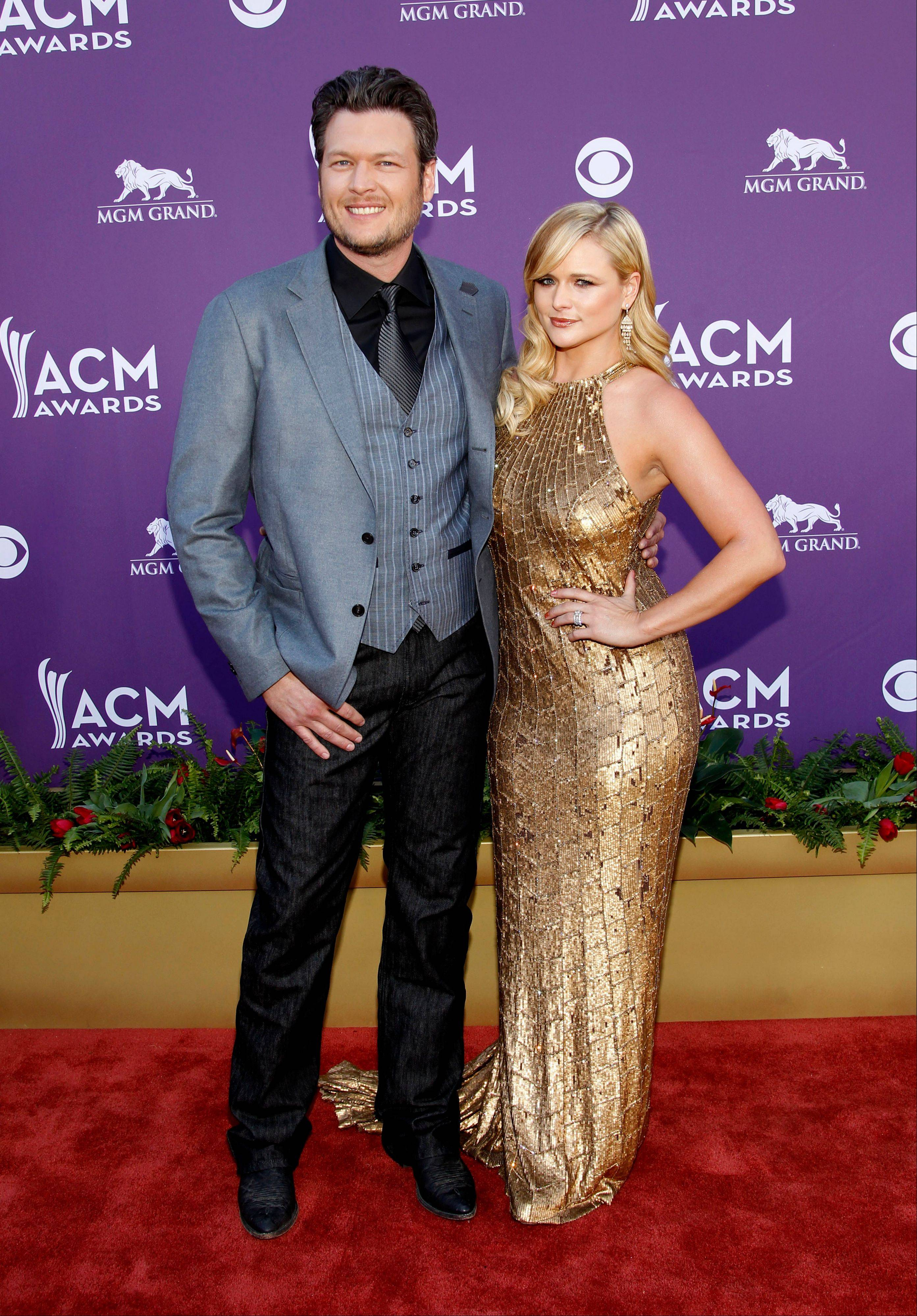 ACM co-host Blake Shelton takes a moment to walk the press line with his wife, singer-songwriter Miranda Lambert, before joining Reba McEntire to emcee the event.