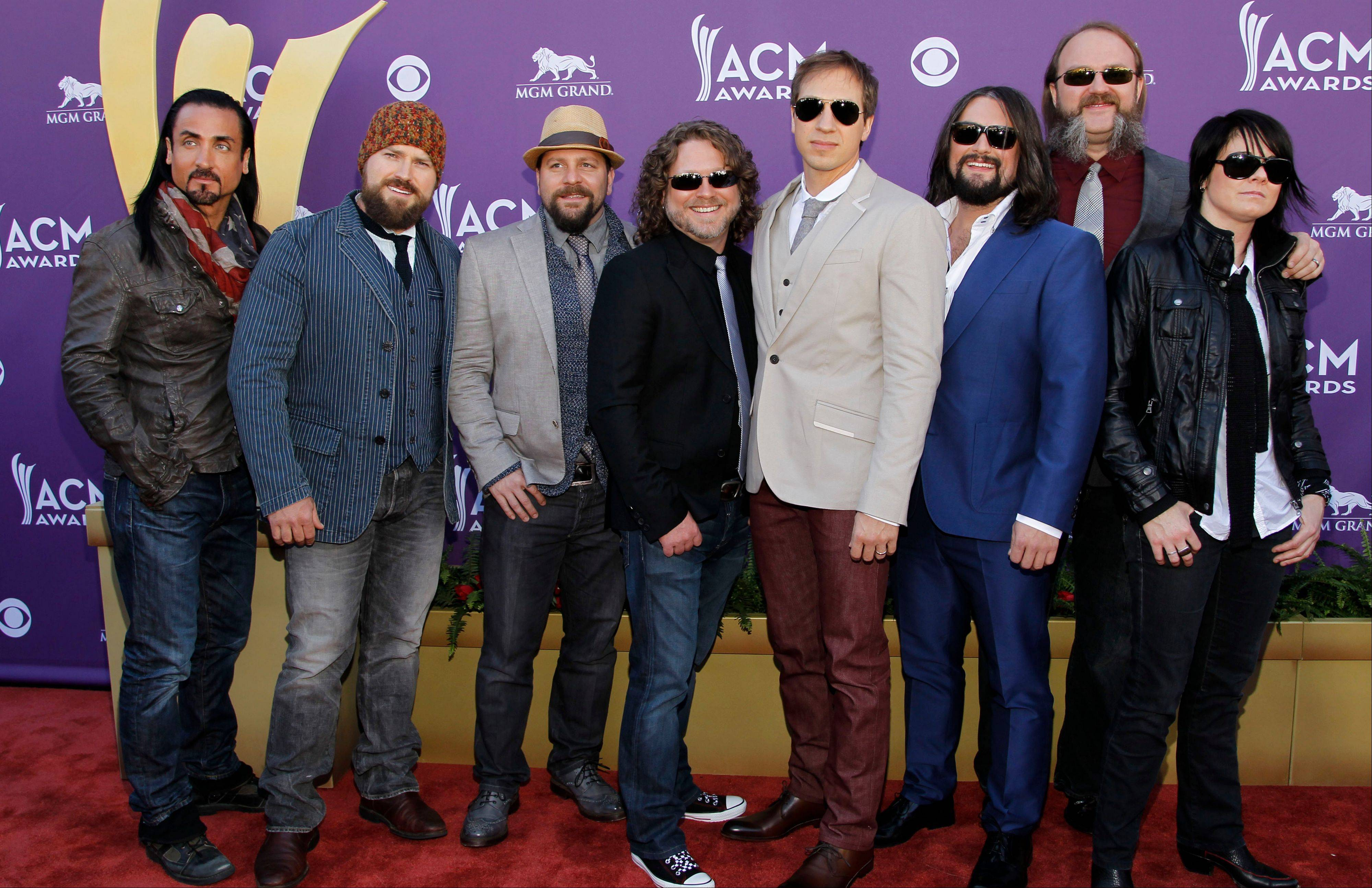 Sonia Leigh, right, and musical group Zac Brown Band arrives at the 47th Annual Academy of Country Music Awards on Sunday, April 1, 2012 in Las Vegas.