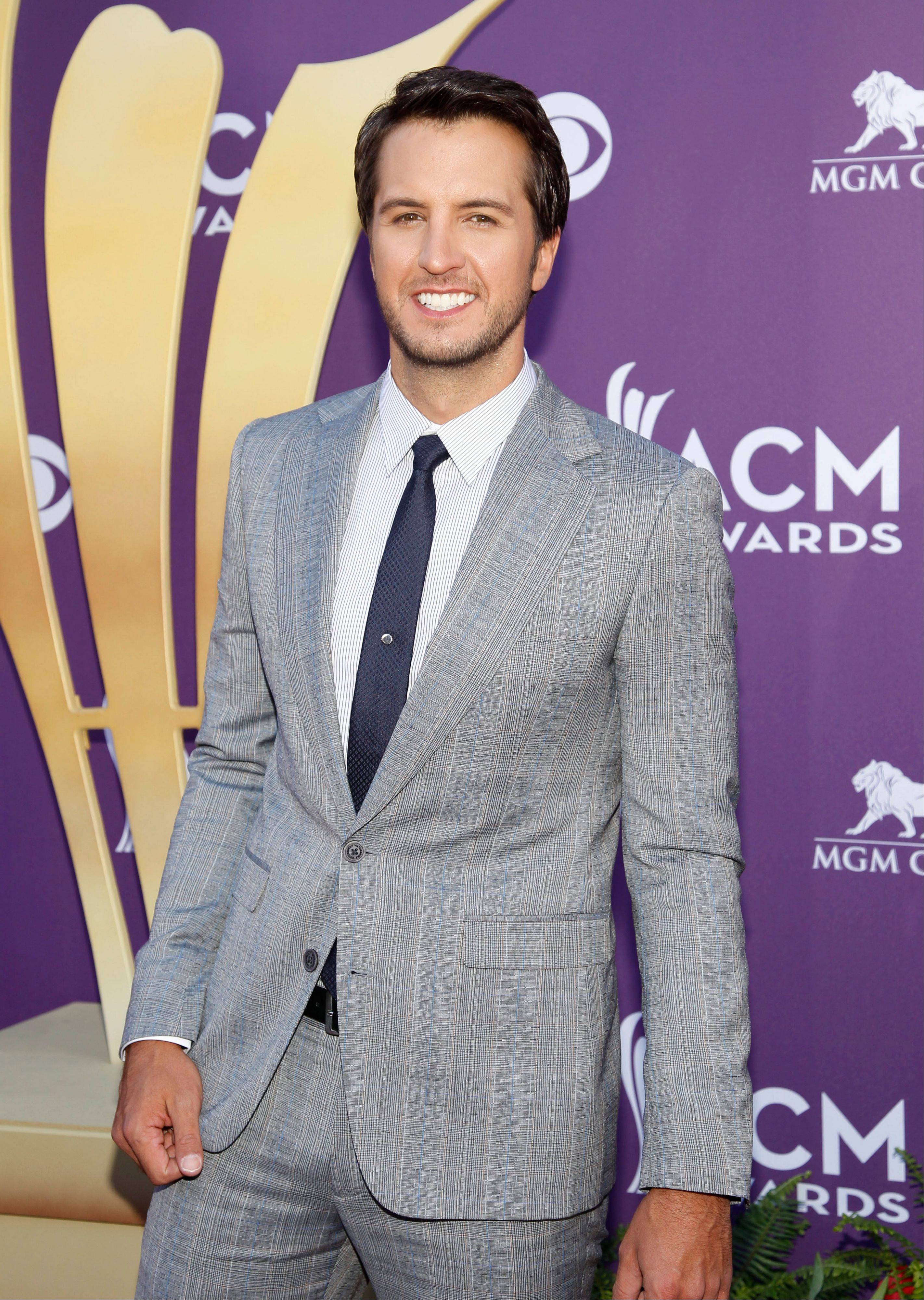 Singer Luke Bryan sports a preppier look with his red carpet get-up.