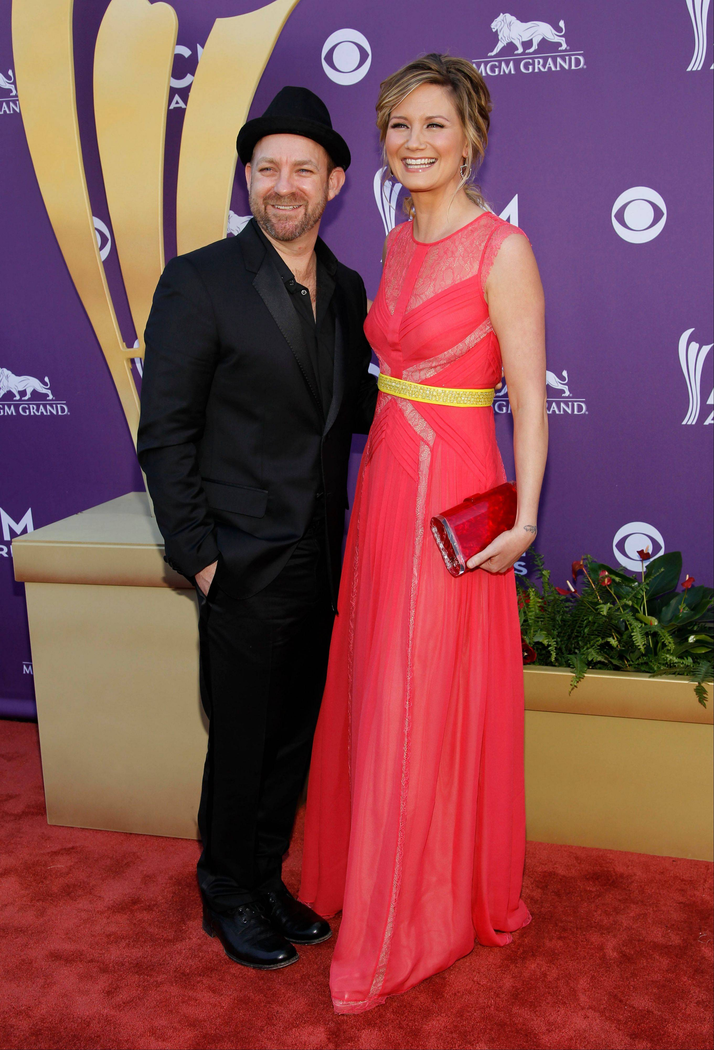 Kristian Bush, left, and Jennifer Nettles, of musical group Sugarland, show no nerves ahead of the ceremony. The duo was up for Vocal Duo of the Year.