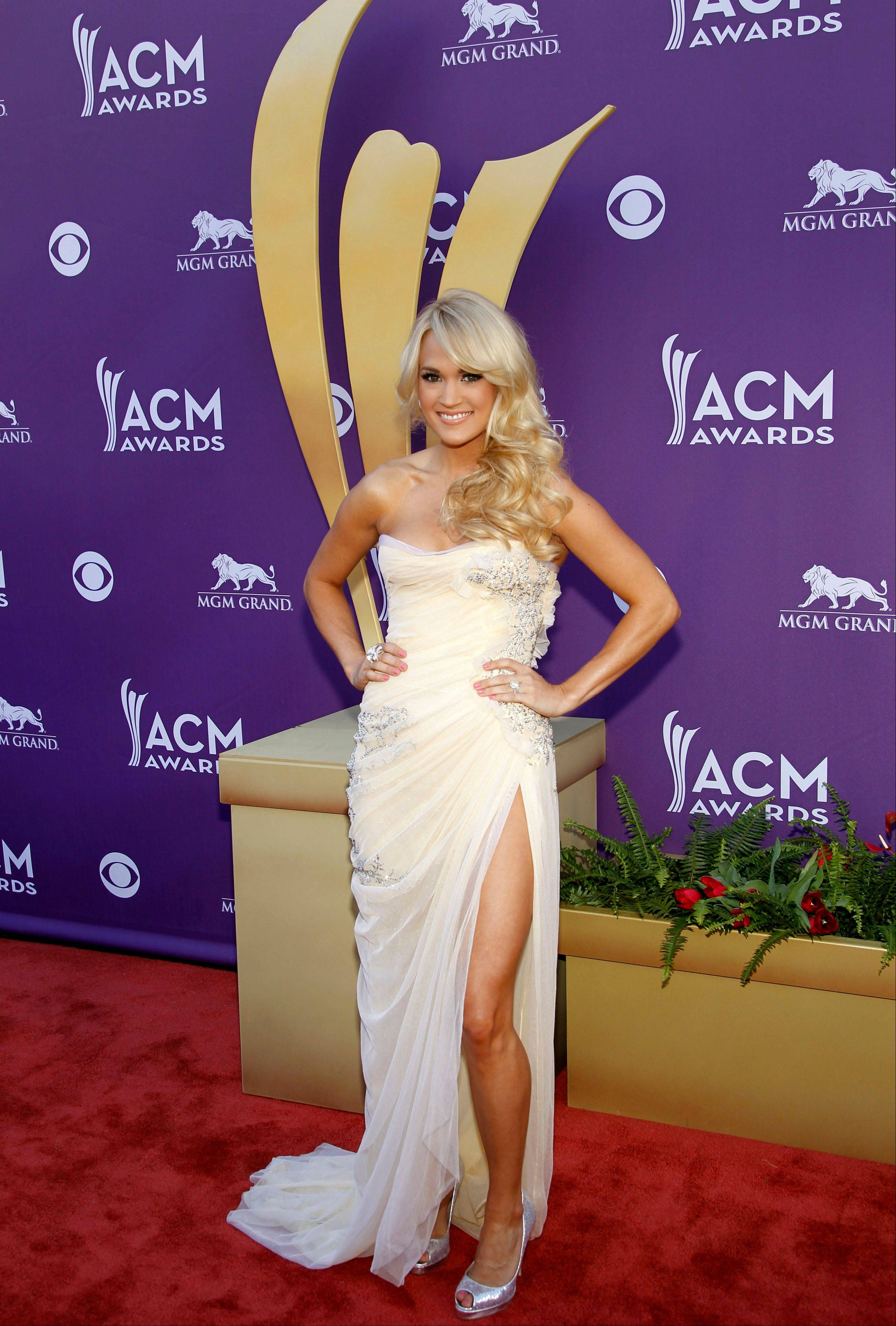 Carrie Underwood who has released her first album in three years continues her streak of glamorous red carpet apperances.