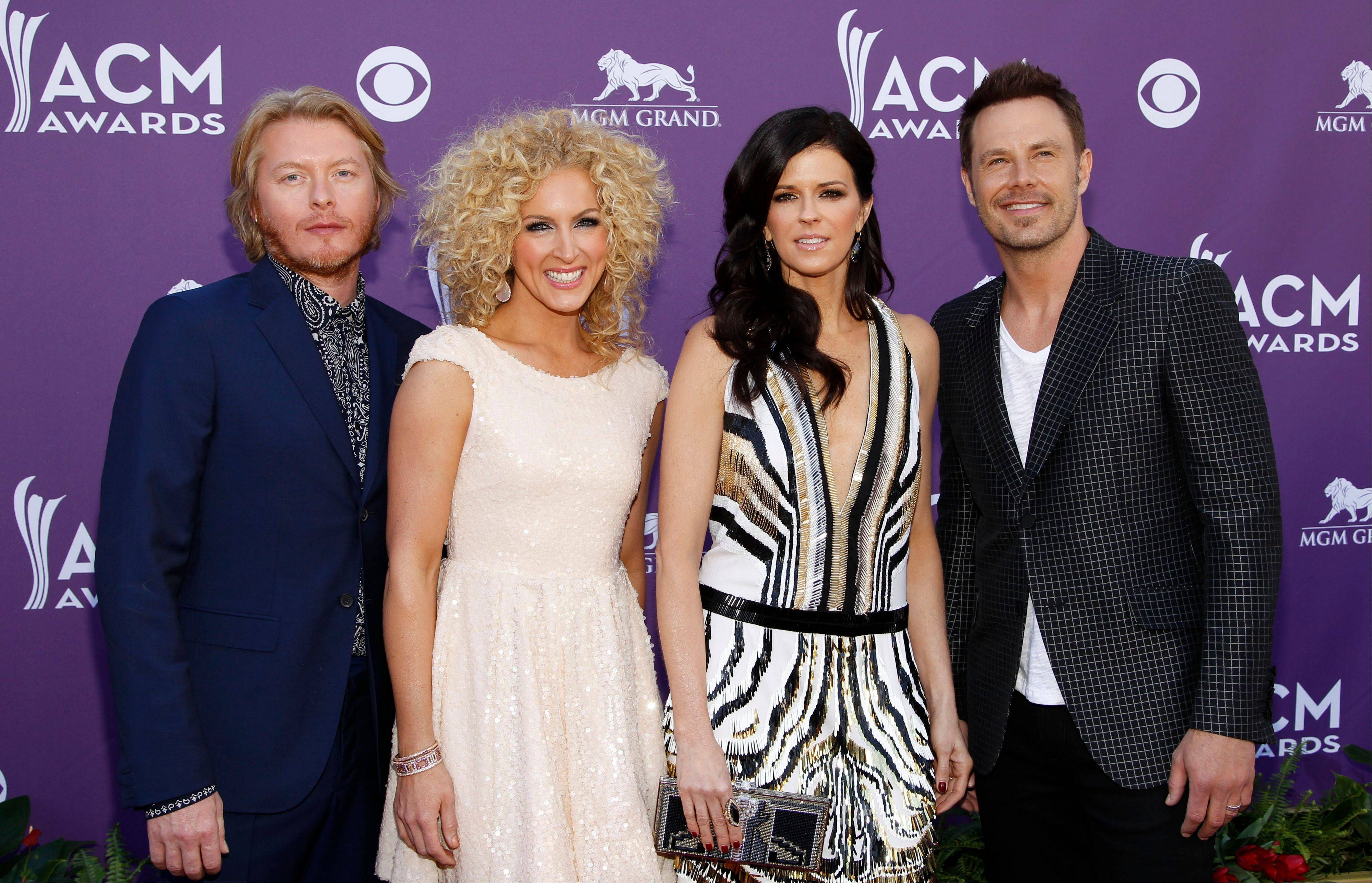 From left, Phillip Sweet, Kimberly Schlapman, Karen Fairchild and Jimi Westbrook, of musical group Little Big Town, arrive at the 47th Annual Academy of Country Music Awards.