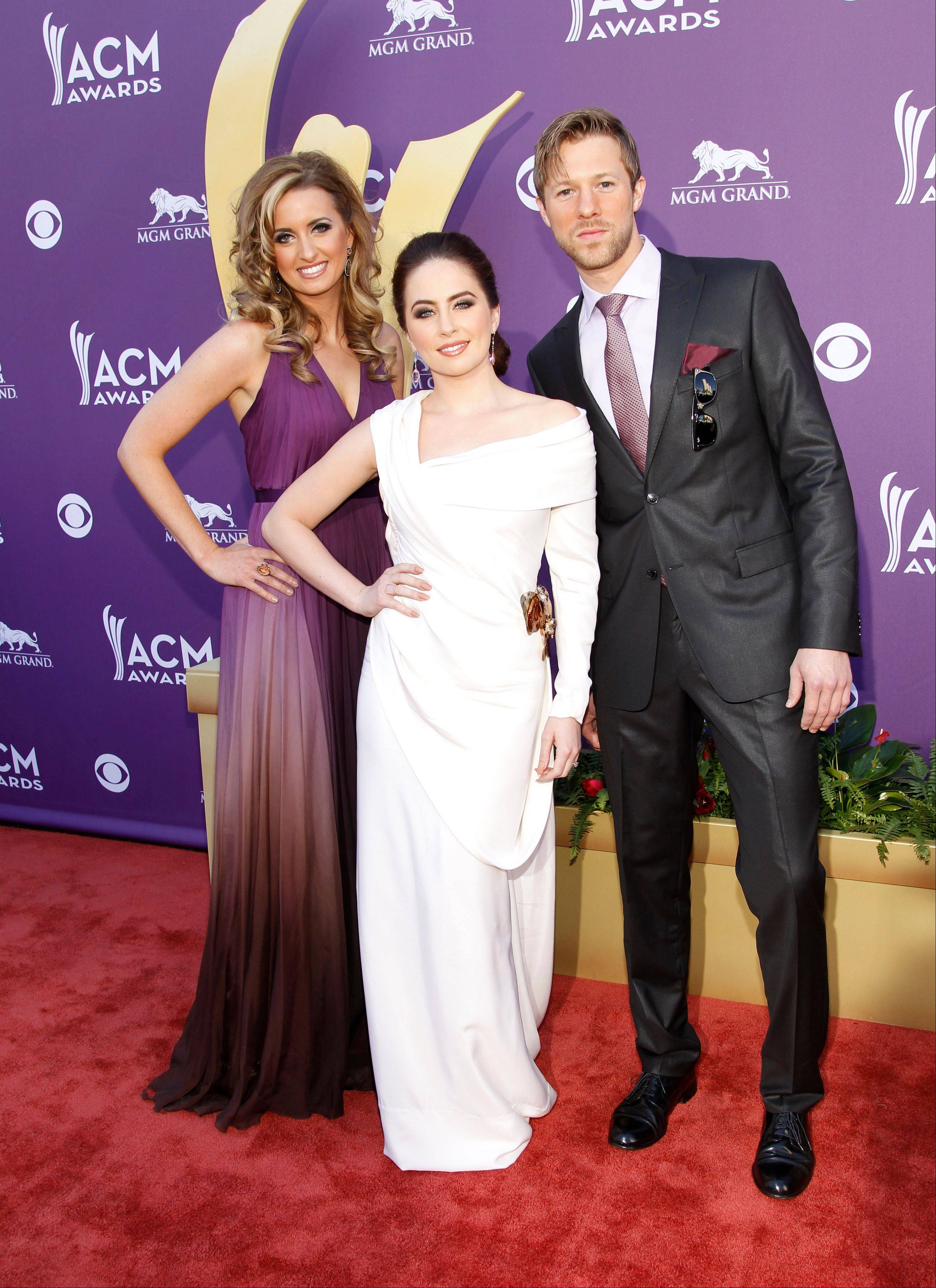 From left, Cherrill Green, Hannah Blaylock and Dean Berner, of musical group Edens Edge arrive at the 47th Annual Academy of Country Music Awards.
