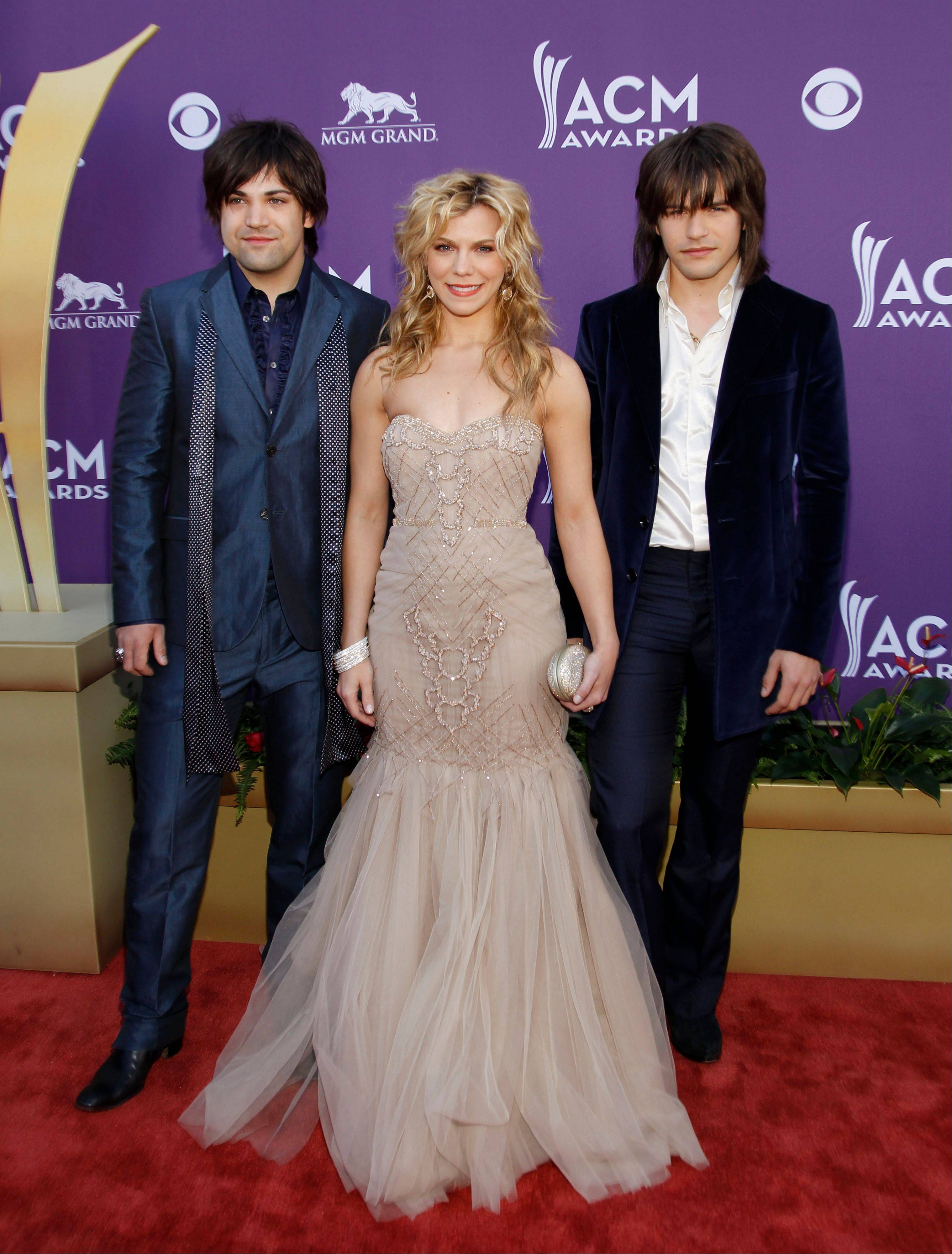From left, Neil Perry, Kimberly Perry and Reid Perry, of musical group The Band Perry, make it a family night. The band is up for Vocal Goup of the Year.