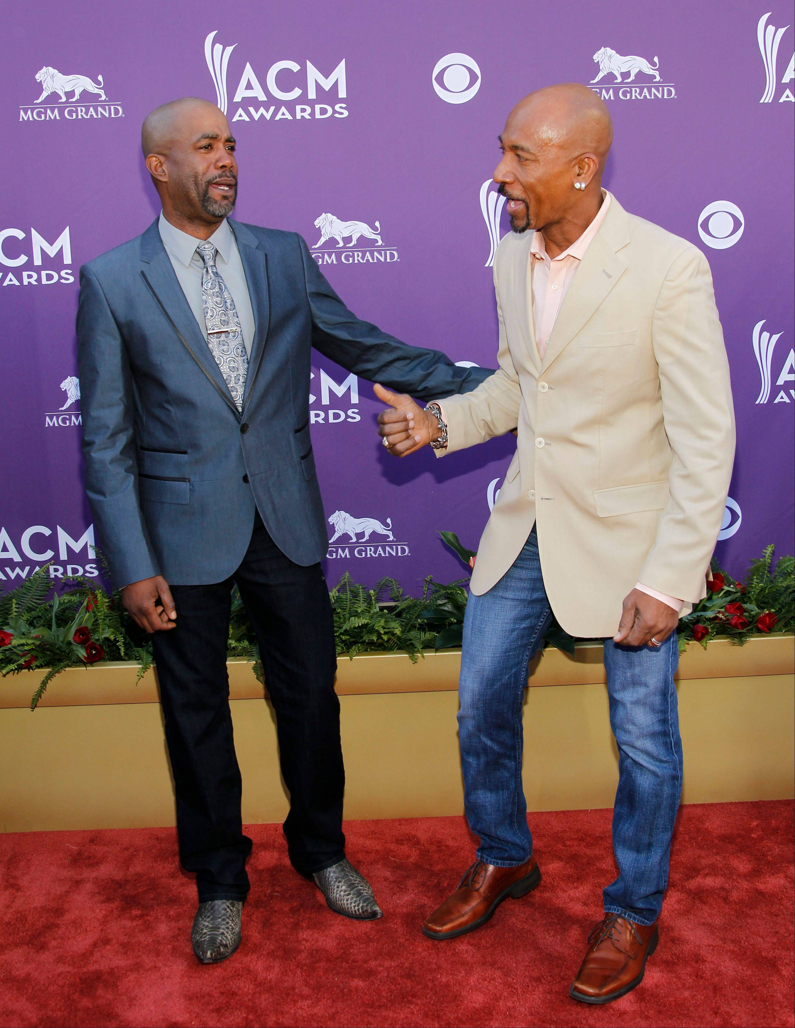 Darius Rucker, left, and Montel Williams have a few laughs before heading into the ceremony.