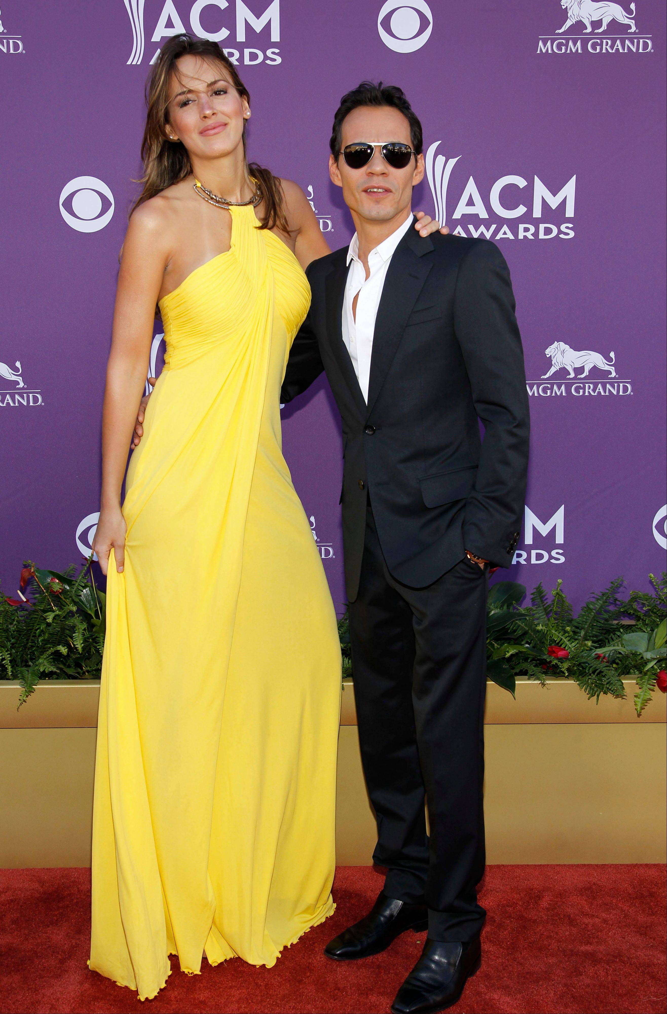 Marc Anthony, seen here with his date Shannon De Lima, was slated to present during the ceremony.