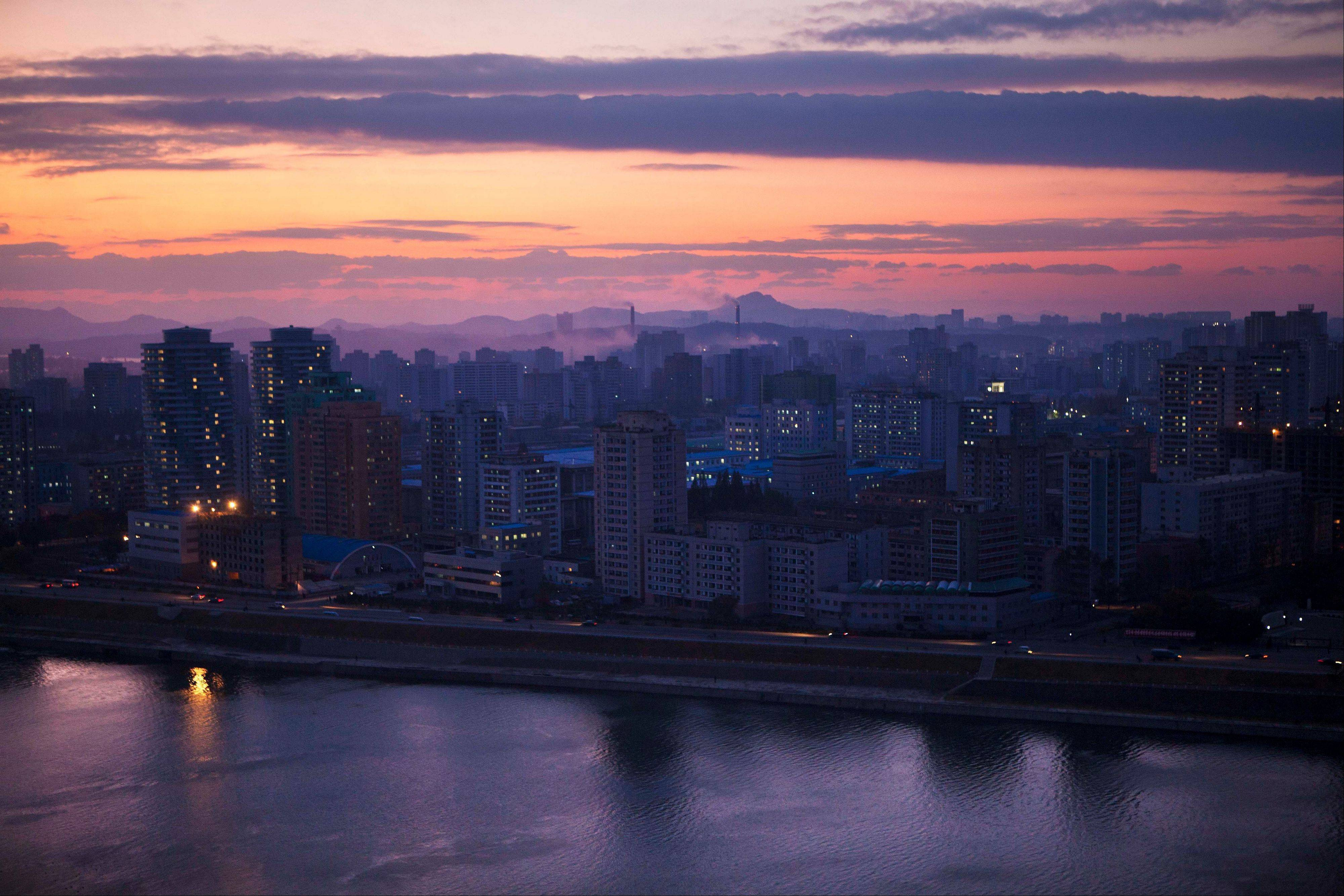 In October 2011, North Korea's capital city, Pyongyang, is lit up at dusk. Throughout the capital, and in cities and towns across the country, construction workers are trying to finish building renovations and major projects as the country prepares for celebrations on April 15 to mark the 100th anniversary of the birth of North Korea founder Kim Il Sung.