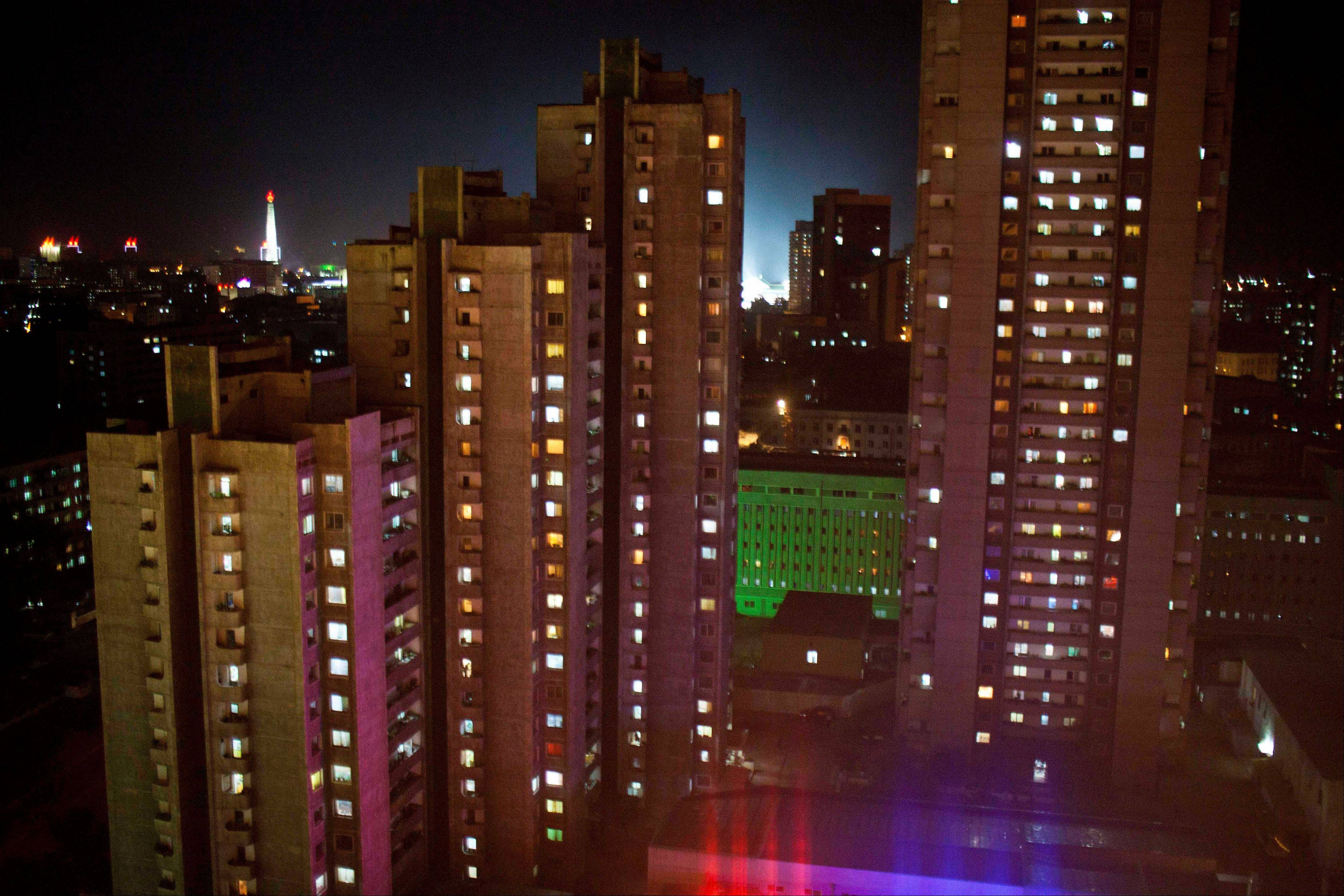 In October 2011, windows of apartment buildings in Pyongyang, North Korea, are lit up at night. Throughout the capital, and in cities and towns across the country, construction workers are trying to finish building renovations and major projects as the country prepares for celebrations on April 15 to mark the 100th anniversary of the birth of North Korea founder Kim Il Sung.
